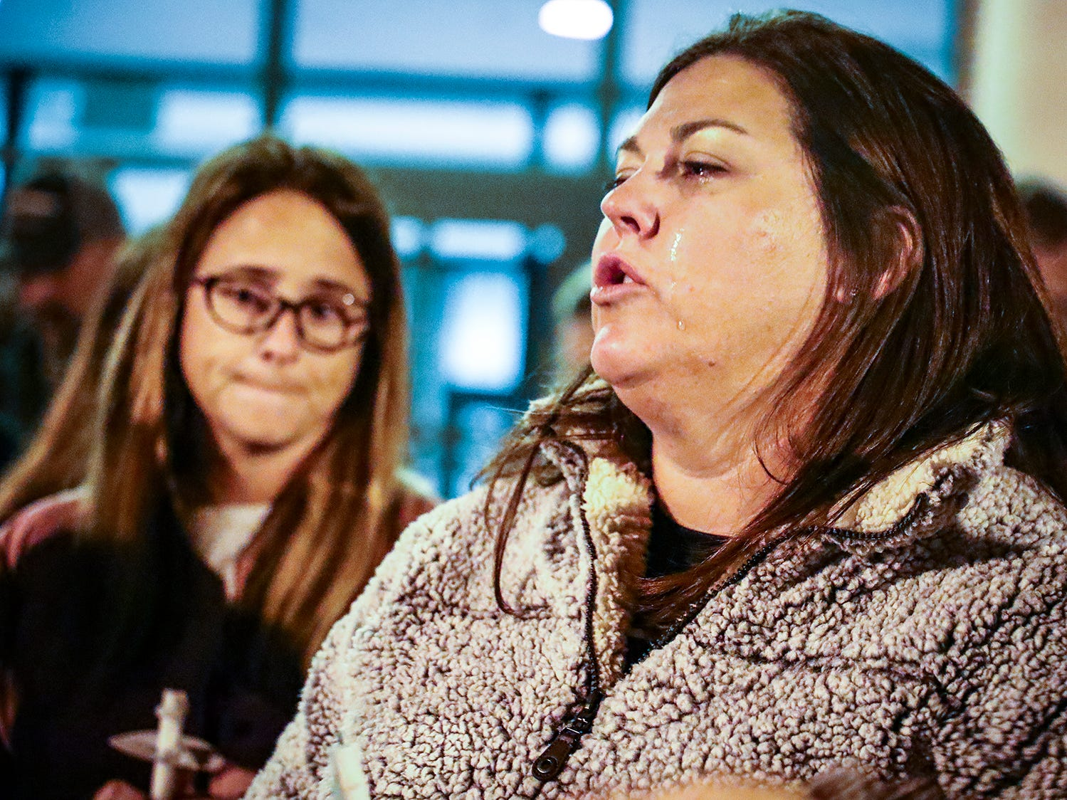 A tear streams down Laurel Jackson's face during a vigil at Eagleville School Tuesday in memory of Angie Walker, who was killed during an EF-2 tornado in Christiana, Tenn.