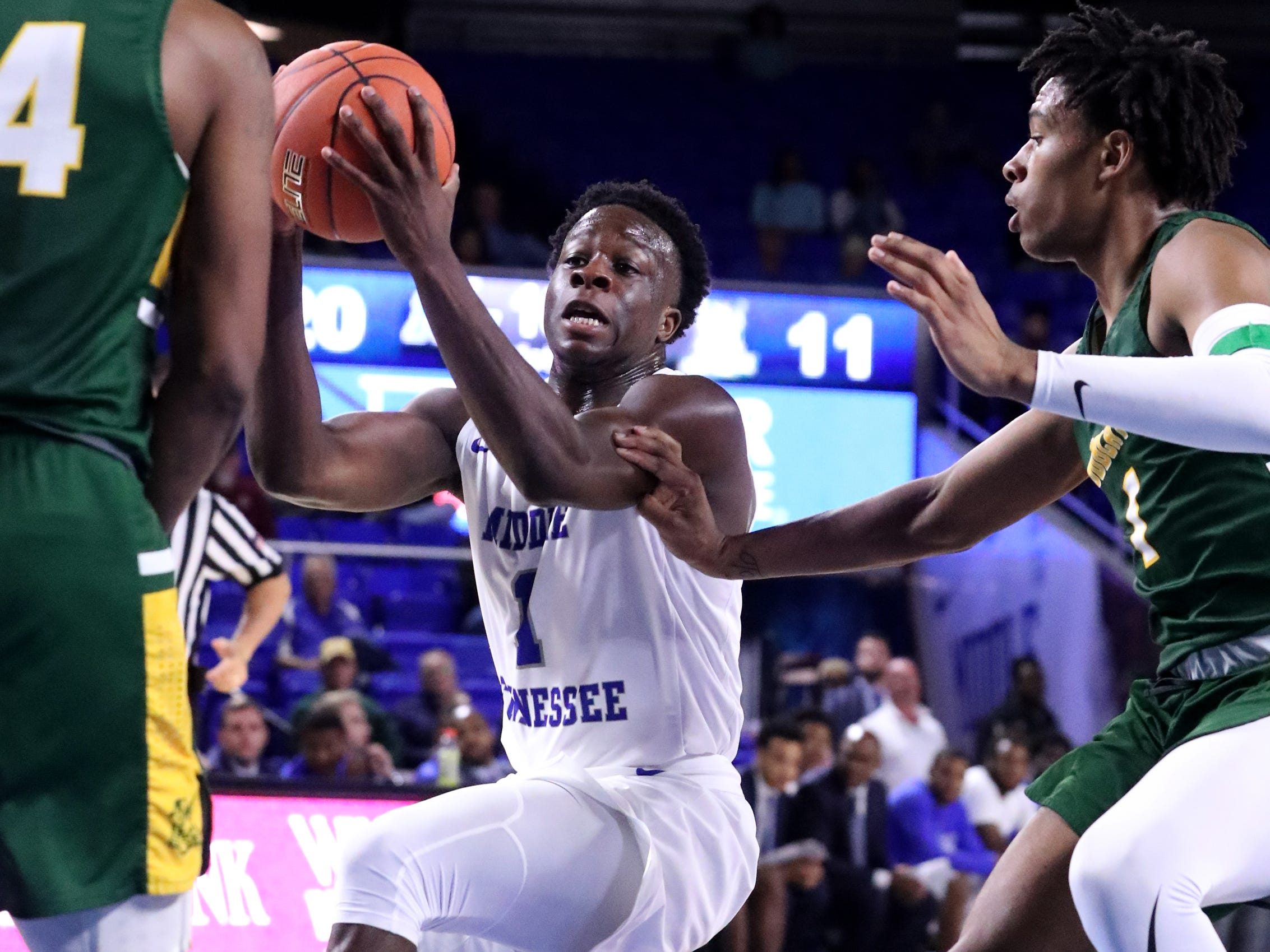 MTSU's Junior Farquhar (1) goes up for a shot as Lees-McRae's () guards him on Tuesday, Nov. 6, 2018.