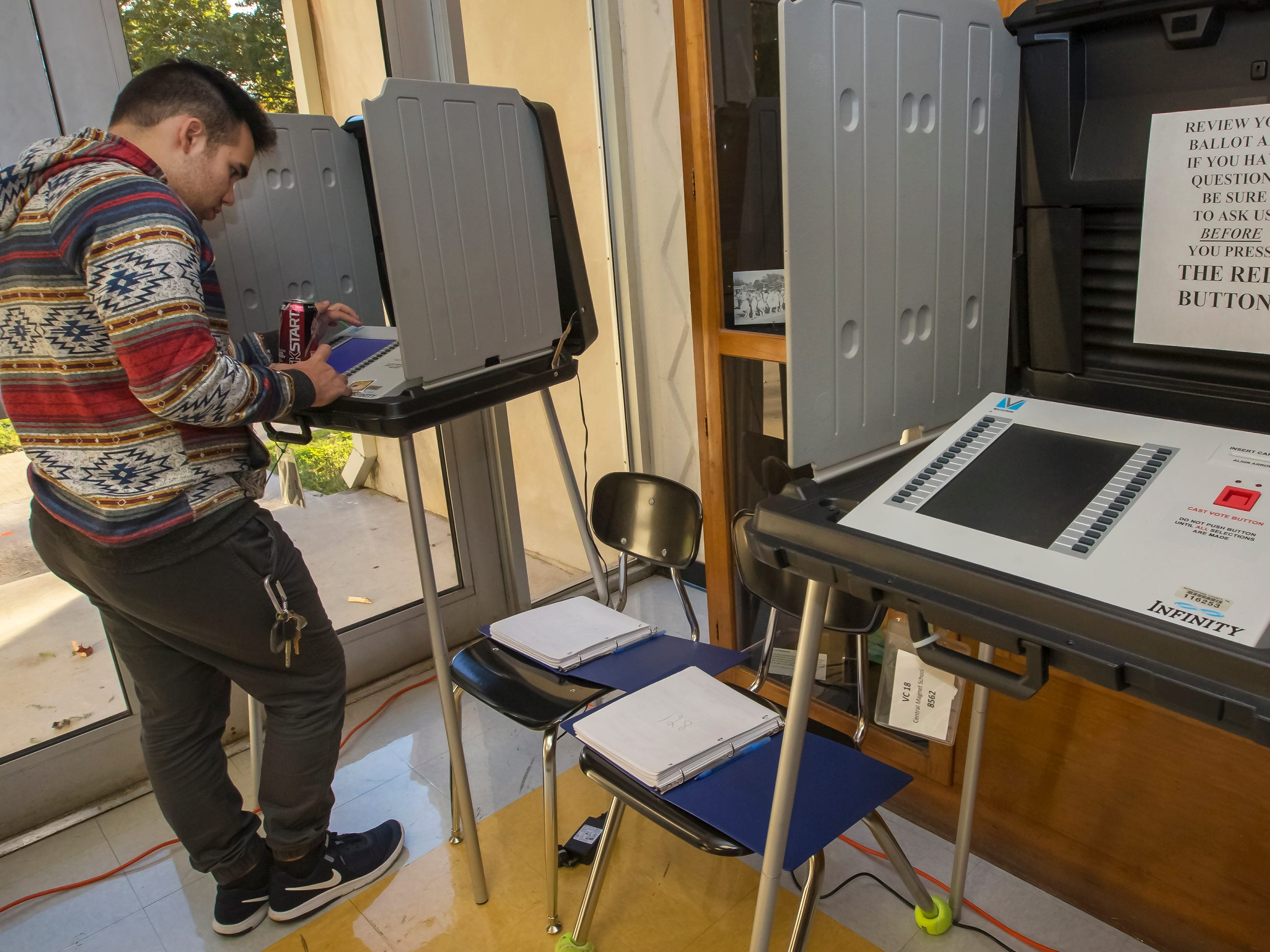 A voter works on his ballot at Central Magnet School.