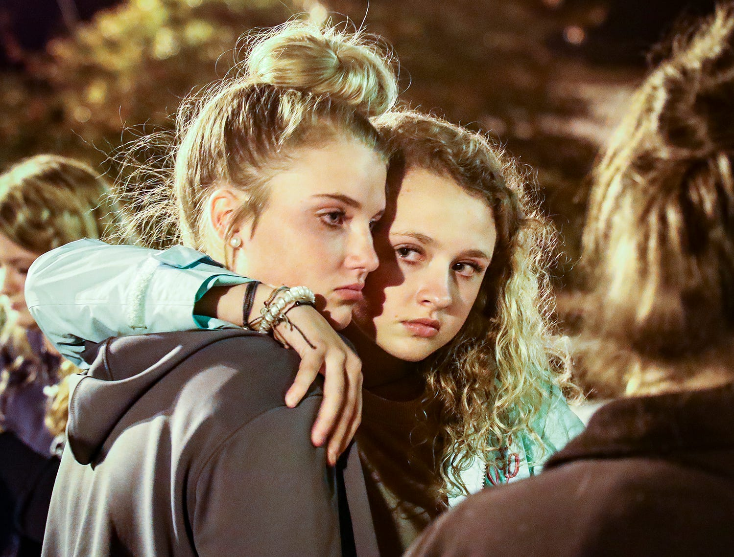 Makayla Garber and Zoe Ellis hold each other close during a vigil in memory of Angie Walker. Walker, 41, was killed in and EF-2 tornado in Christiana, Tenn., on Tuesday, Nov. 6, 2018.