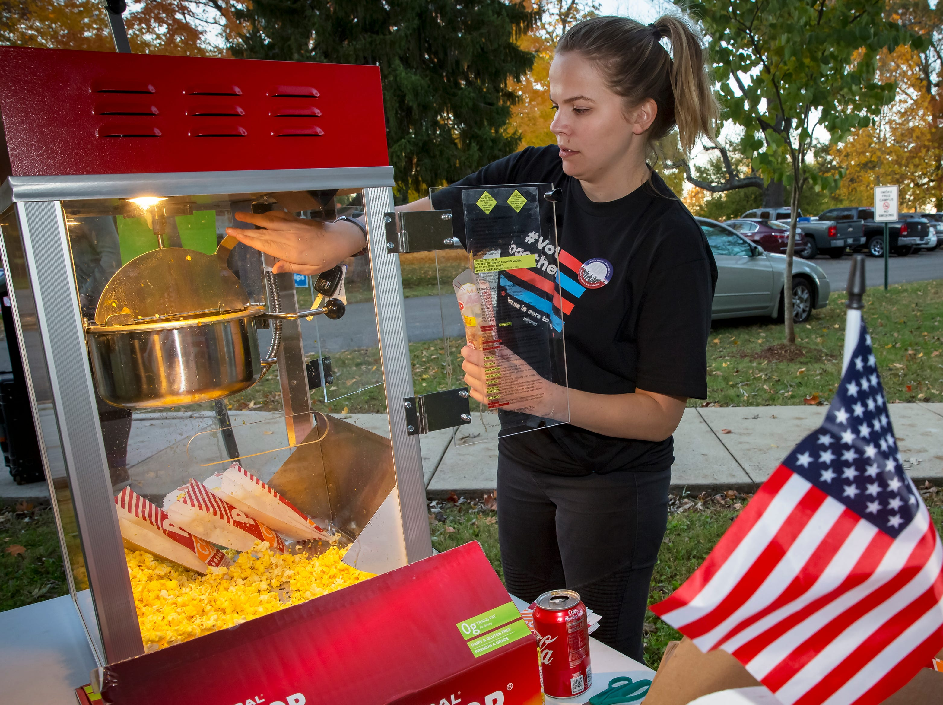 """Sarah Williams makes popcorn at MTSU's """"Party at the Polls"""" election-day event held at Central Magnet School."""