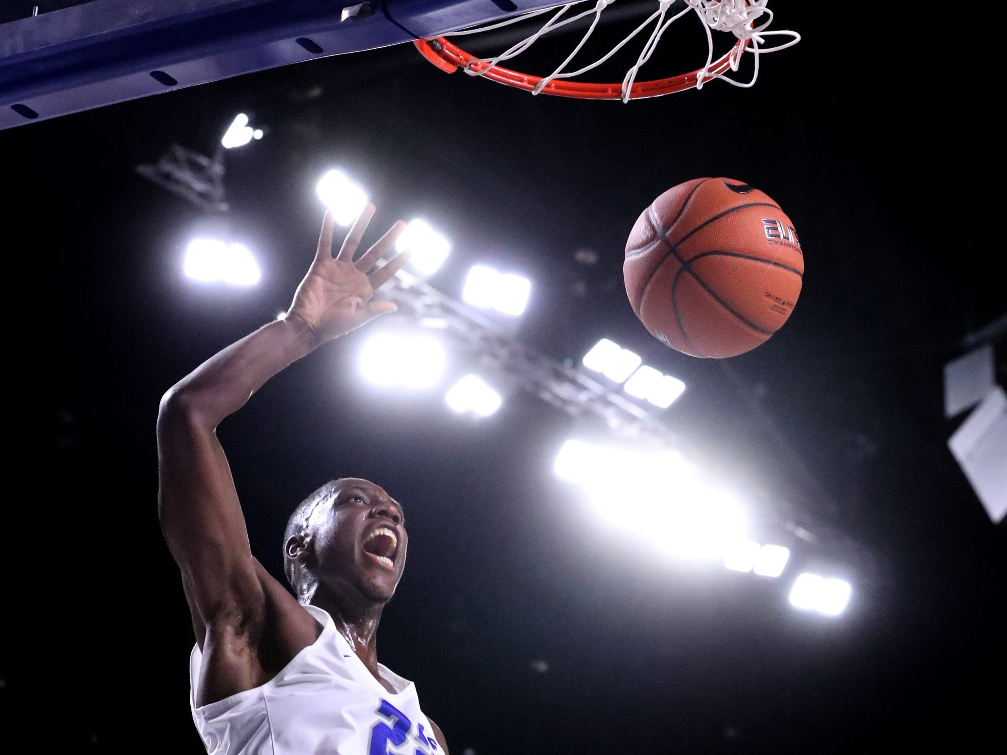 MTSU's Reggie Scurry (22) dunks the ball against Lees-McRae on Tuesday, Nov. 6, 2018.