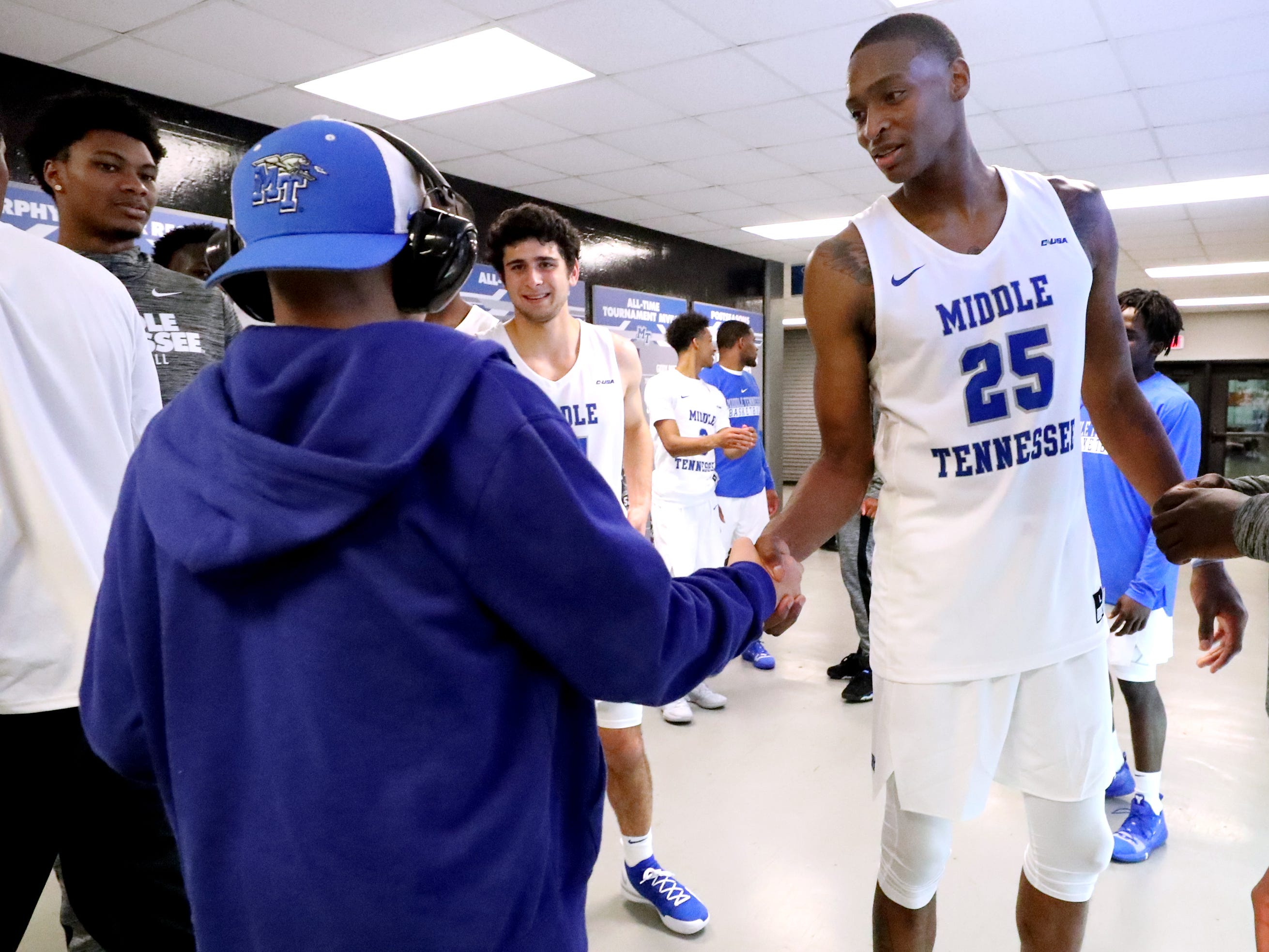 MTSU's Karl Gamble (25) thanks fans for coming to the game as they leave after MTSU defeated Lees-McRae on Tuesday, Nov. 6, 2018.