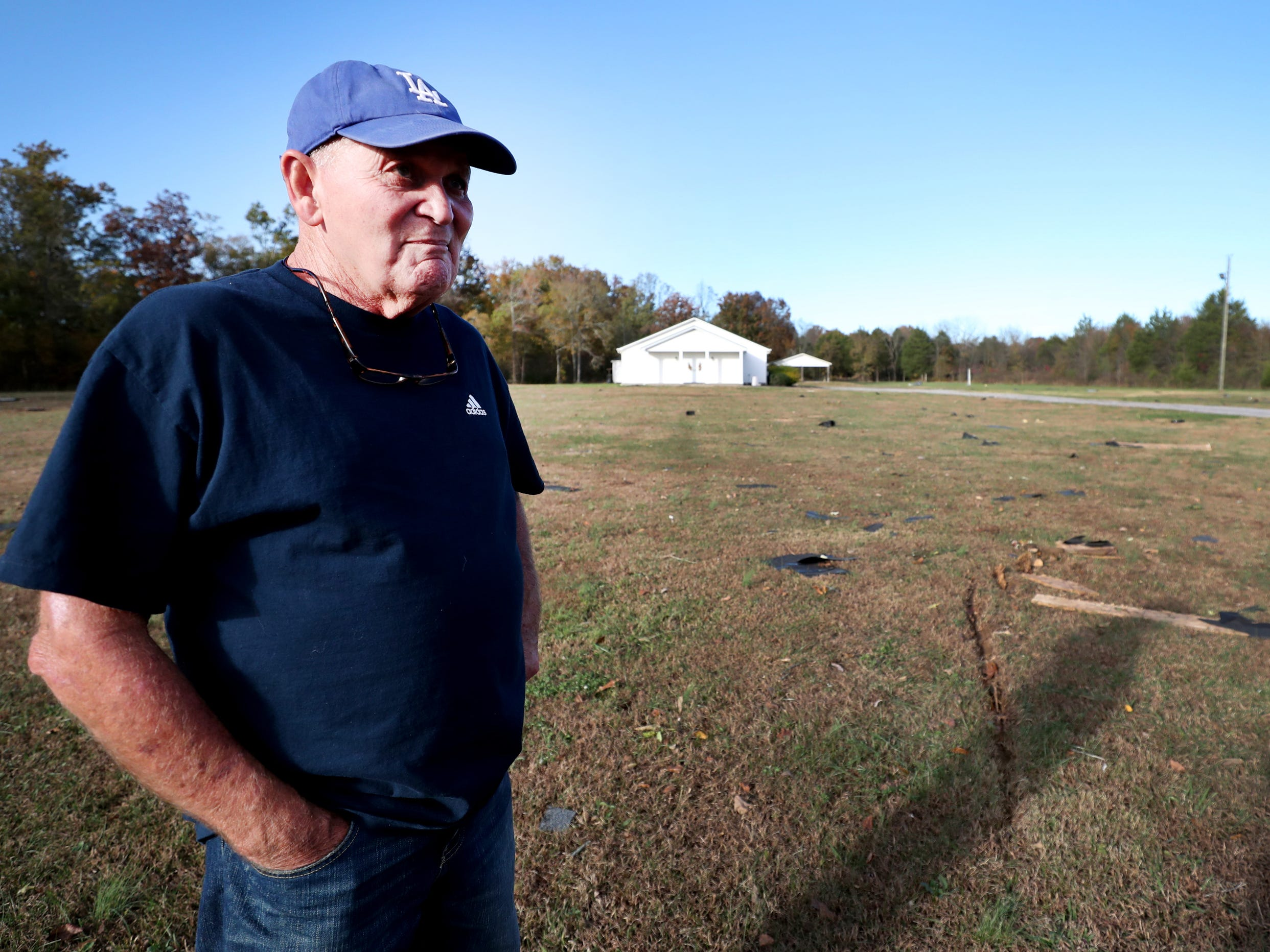 Billy Grimes Sr. looks for his friend's items that might have blown into the yard of the South Boros Pentecostals Church following a tornado that occurred  overnight, on Rock Springs Midland Road in Christiana, Tenn. on Tuesday, Nov. 6, 2018.