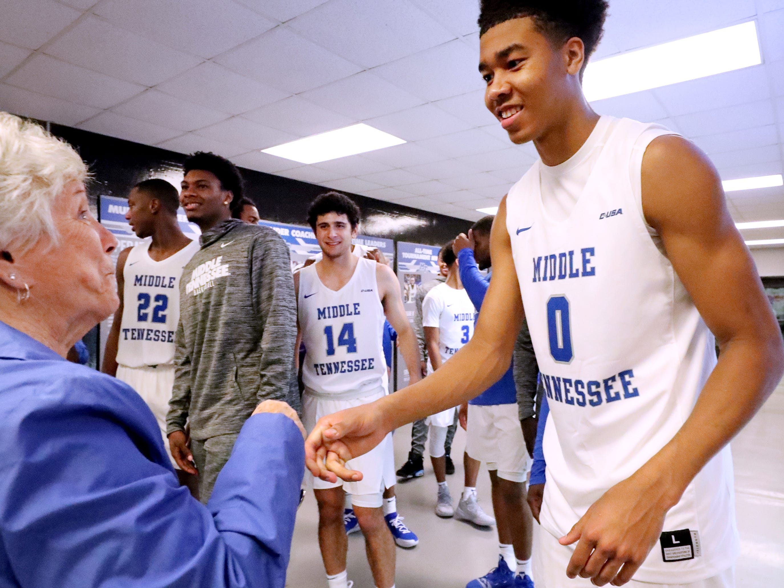 MTSU's Anthony Crump (0) thanks fans for coming to the game as they leave after MTSU defeated Lees-McRae on Tuesday, Nov. 6, 2018.