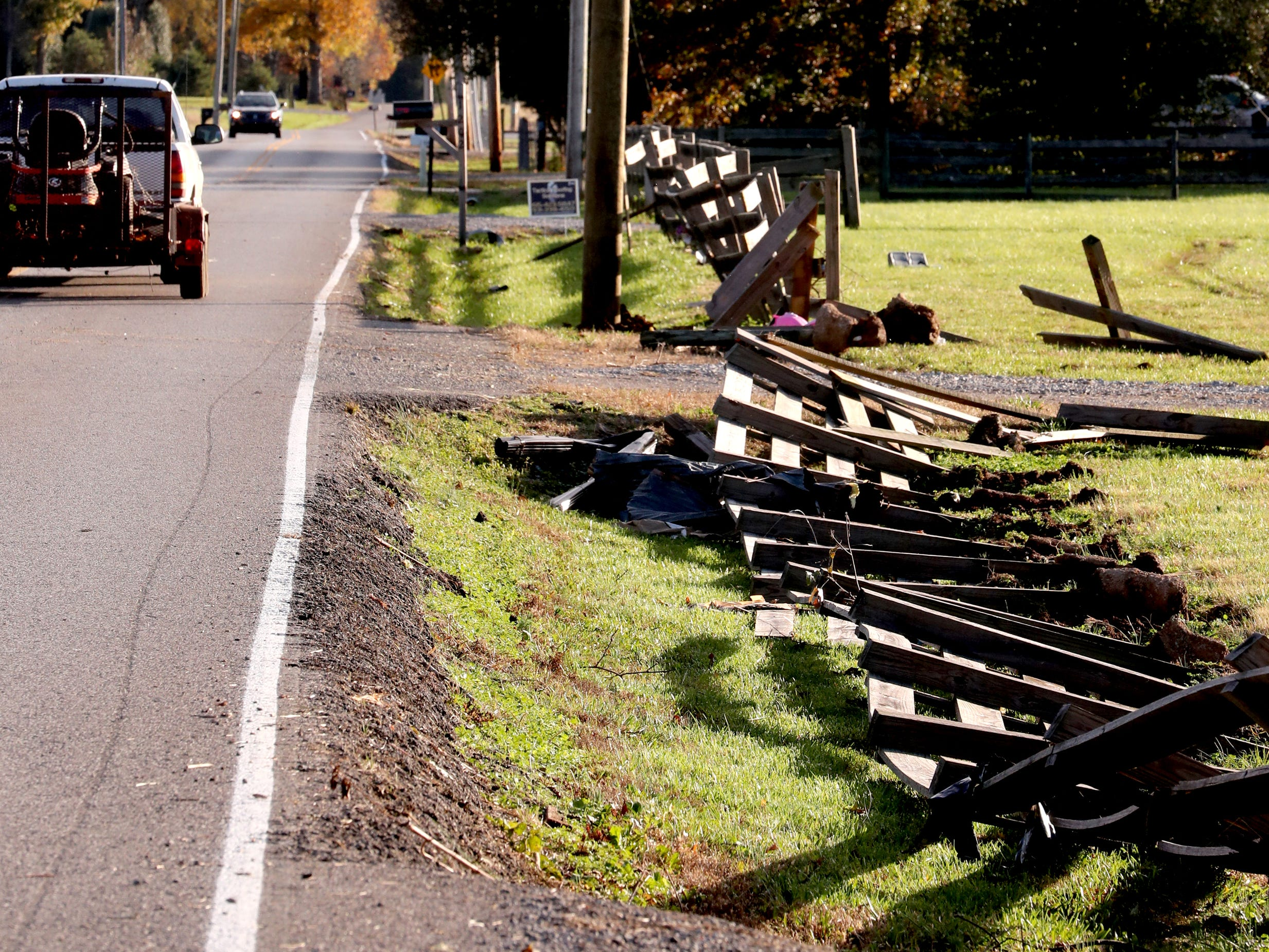 A wooden fence that runs along Rock Springs Midland Road in Christiana, Tenn. was knocked down due to a tornado that hit the area early on Tuesday, Nov. 6, 2018.