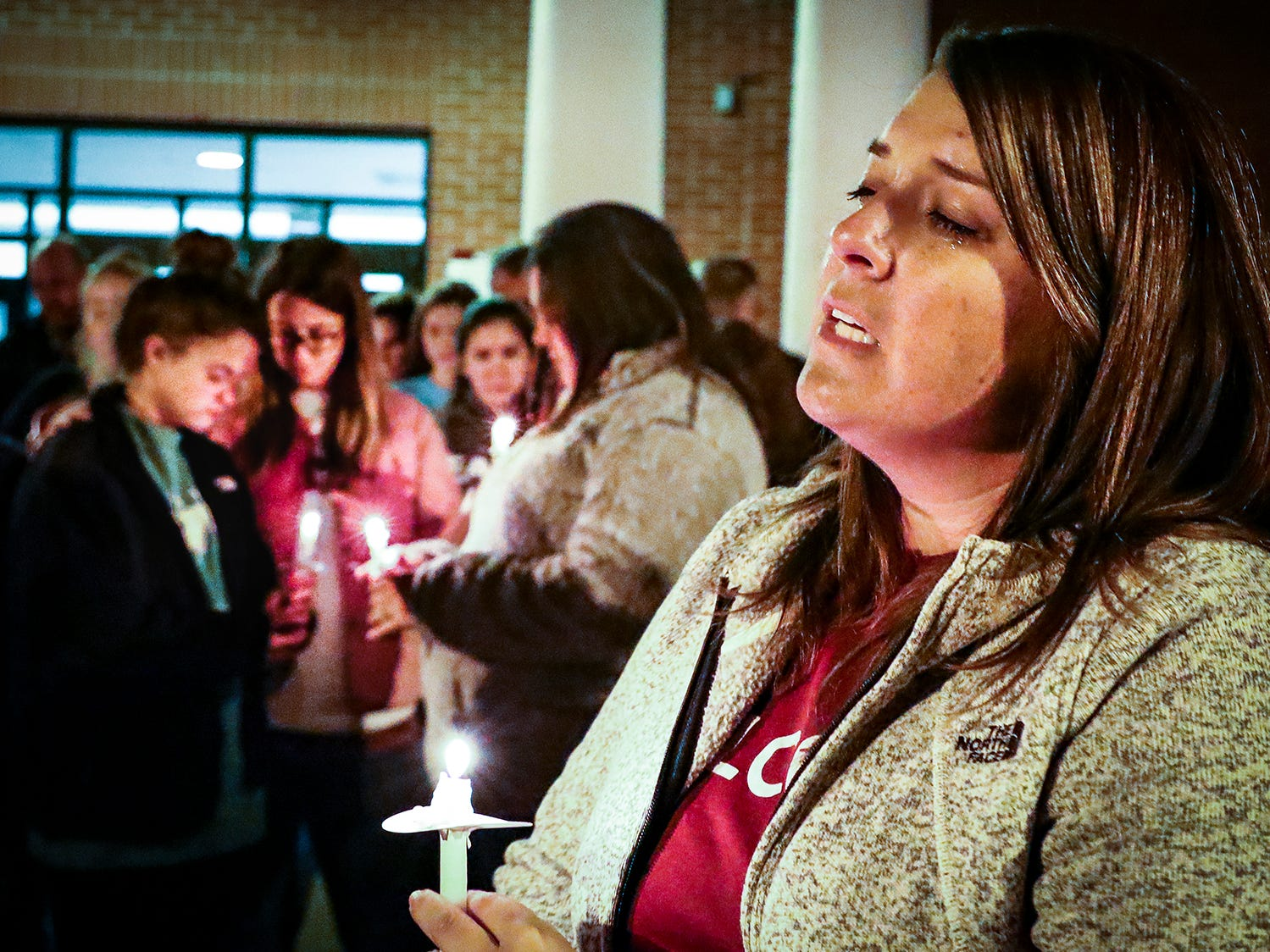 Samantha Jackson leads prayer for those gathered at a vigil for tornado victim Angie Walker held at Eagleville School. Walker, 41, was killed in and EF-2 tornado in Christiana, Tenn., on Tuesday, Nov. 6, 2018.