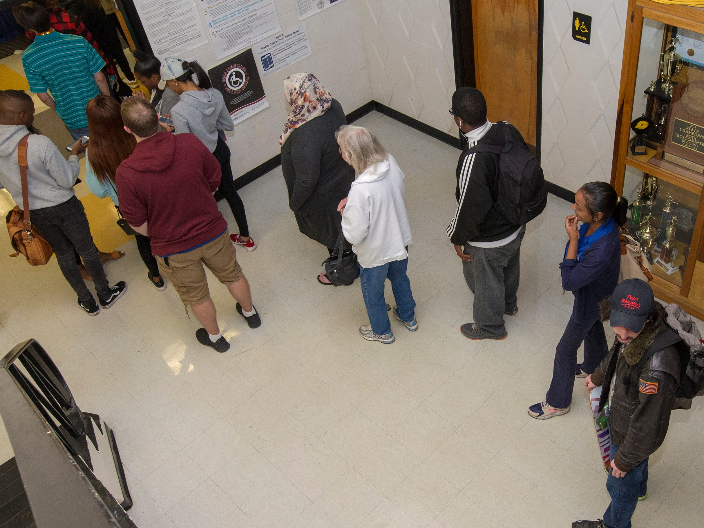 Voters wait in line at Central Magnet School Tuesday afternoon.