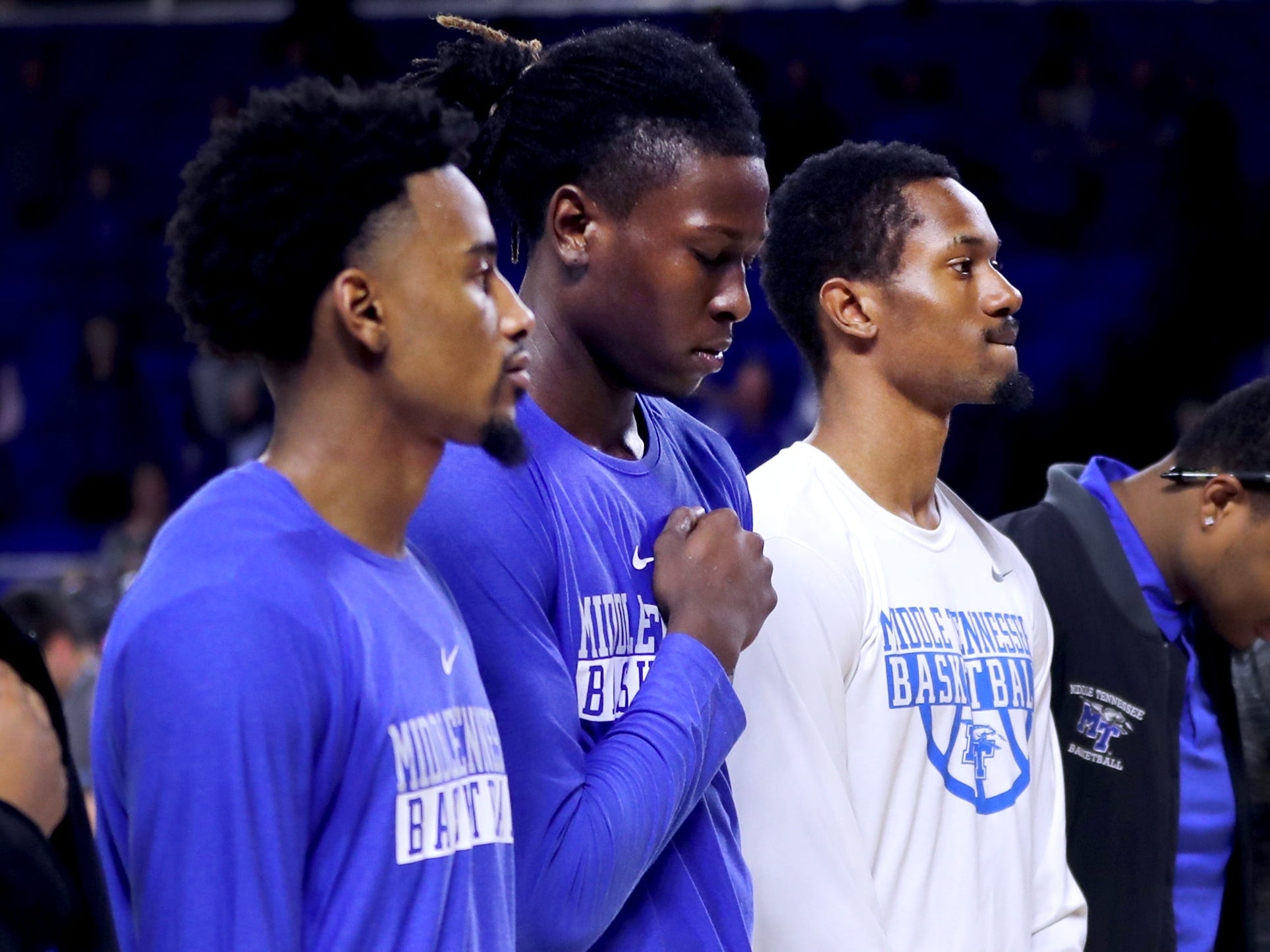MTSU players have a moment of silence for MTSU Alumni and adjunct professor Angie Walker, who died in due to a tornado early Tuesday morning before the start of the game against Lees-McRae on Tuesday, Nov. 6, 2018.