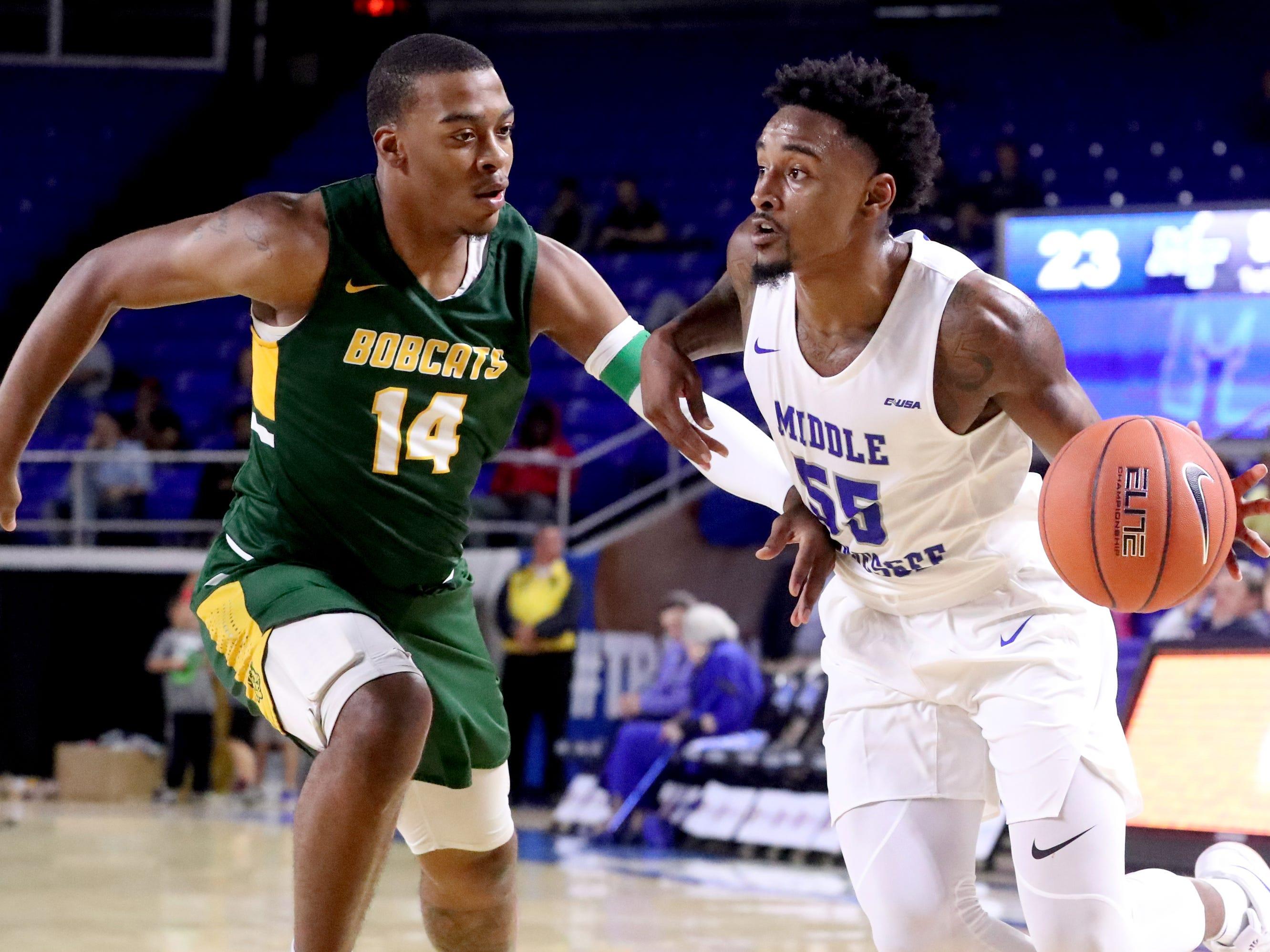 MTSU's Antonio Green (55) pushes toward the basket as Lees-McRae's Malik Wright (14) guards him on Tuesday, Nov. 6, 2018.