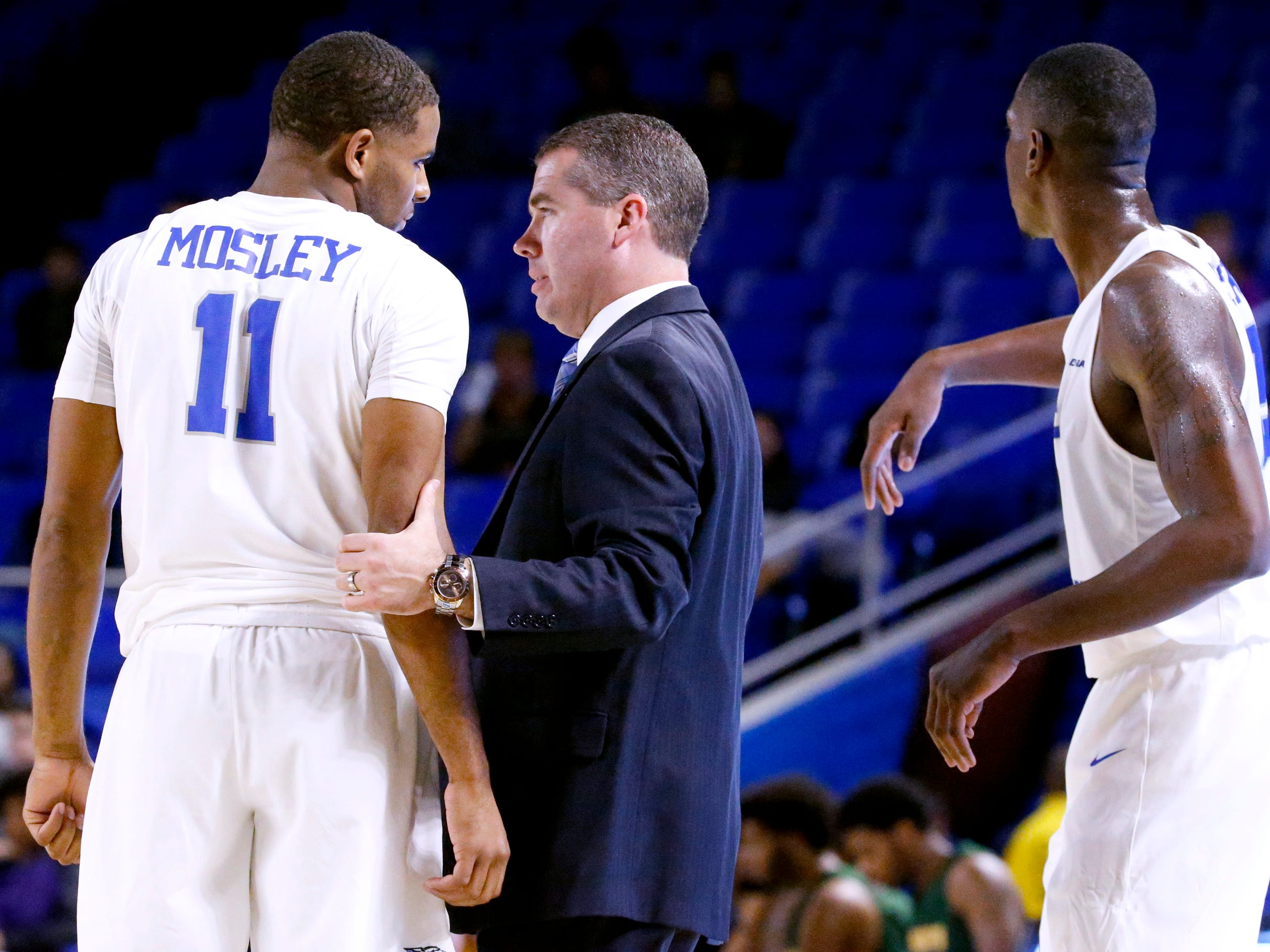 MTSU's head coach Nick McDevitt works with Lawrence Mosley (11) on sidelines during the game against Lees-McRae on Tuesday, Nov. 6, 2018.