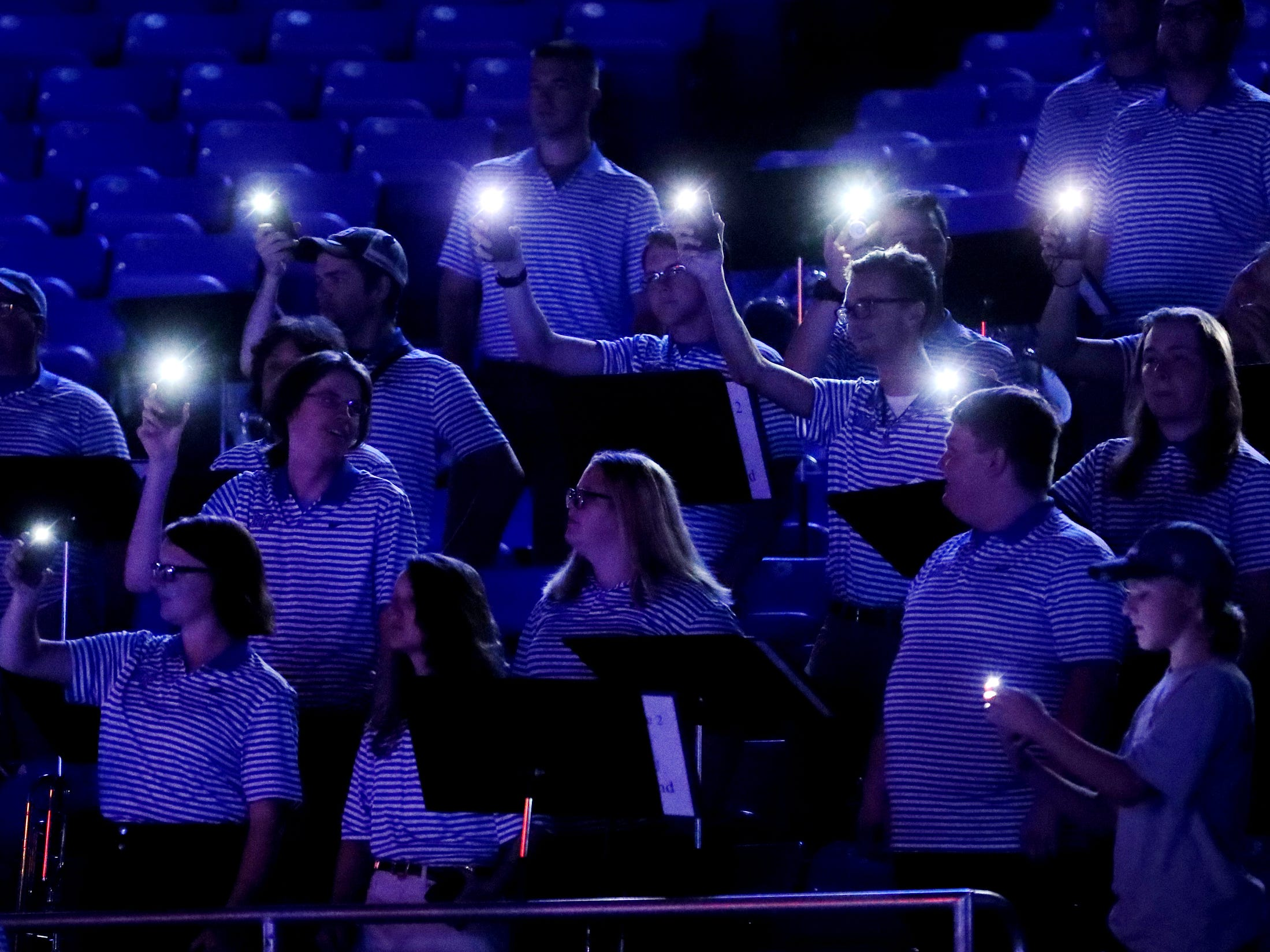 MTSU band members shine their phone lights before the MTSU players are announced before the game against Lees-McRae on Tuesday, Nov. 6, 2018.