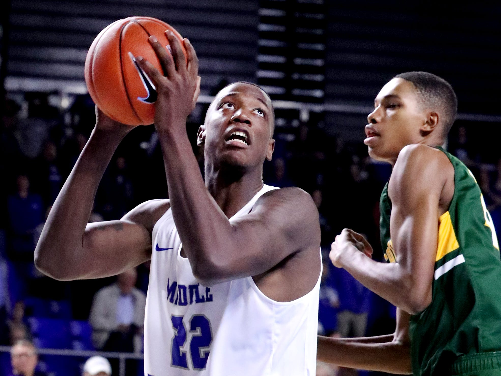 MTSU's Reggie Scurry (22) goes for a shot as Lees-McRae's Michael Harris (21) guards him on Tuesday, Nov. 6, 2018.
