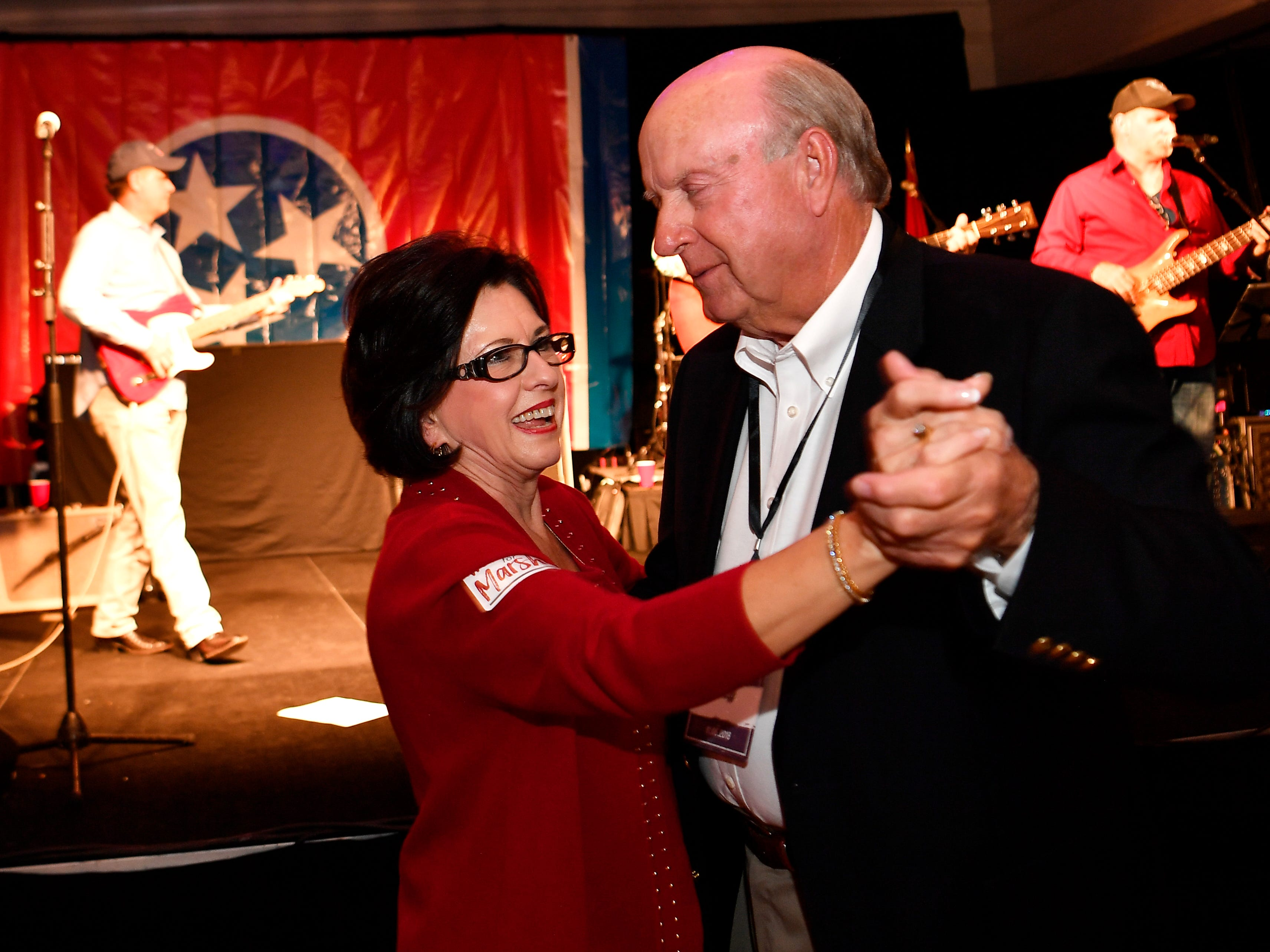 Donna Choate and Cary Johnson dance at the election night watch party for Republican U.S. Senate candidate Marsha Blackburn Tuesday, Nov. 6, 2018, in Franklin, Tenn.