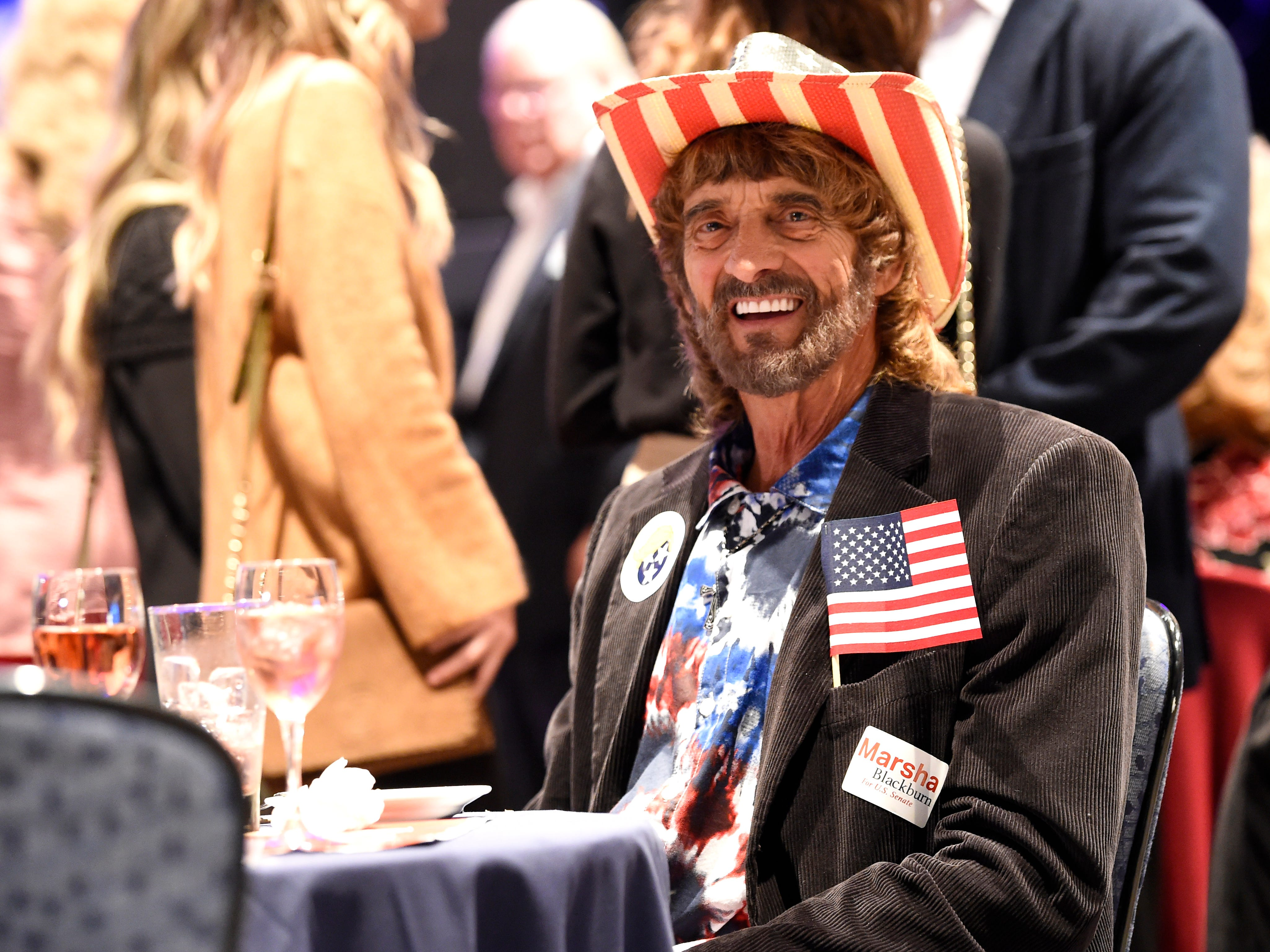 Robert Payne is decked out in red, white and blue at the election night watch party for Republican U.S. Senate candidate Marsha Blackburn  Tuesday, Nov. 6, 2018, in Franklin, Tenn.