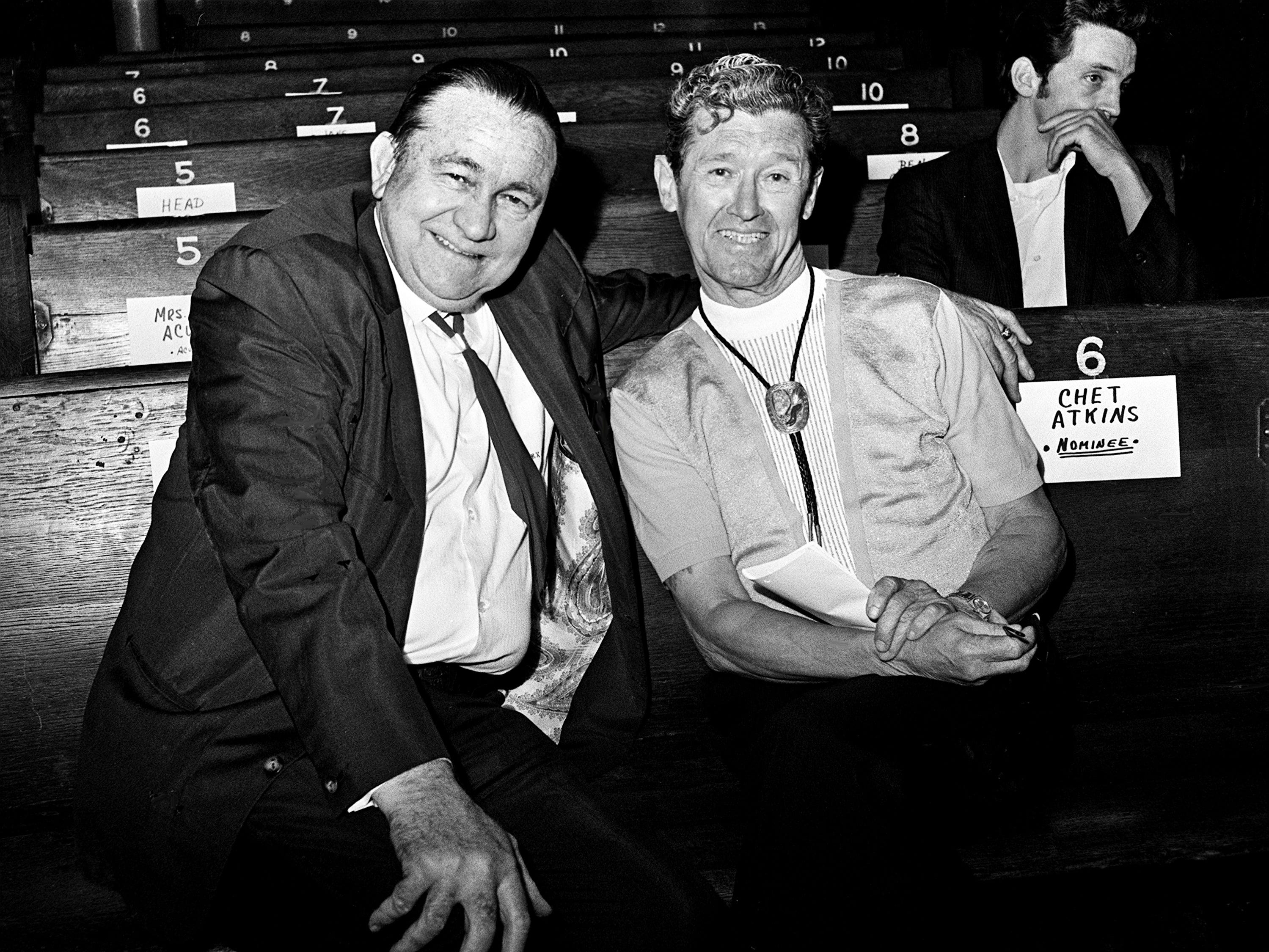 Tex Ritter, left, and Roy Acuff relax during rehearsal at the Grand Ole Opry on Oct. 18, 1968, for that night's CMA Awards show.