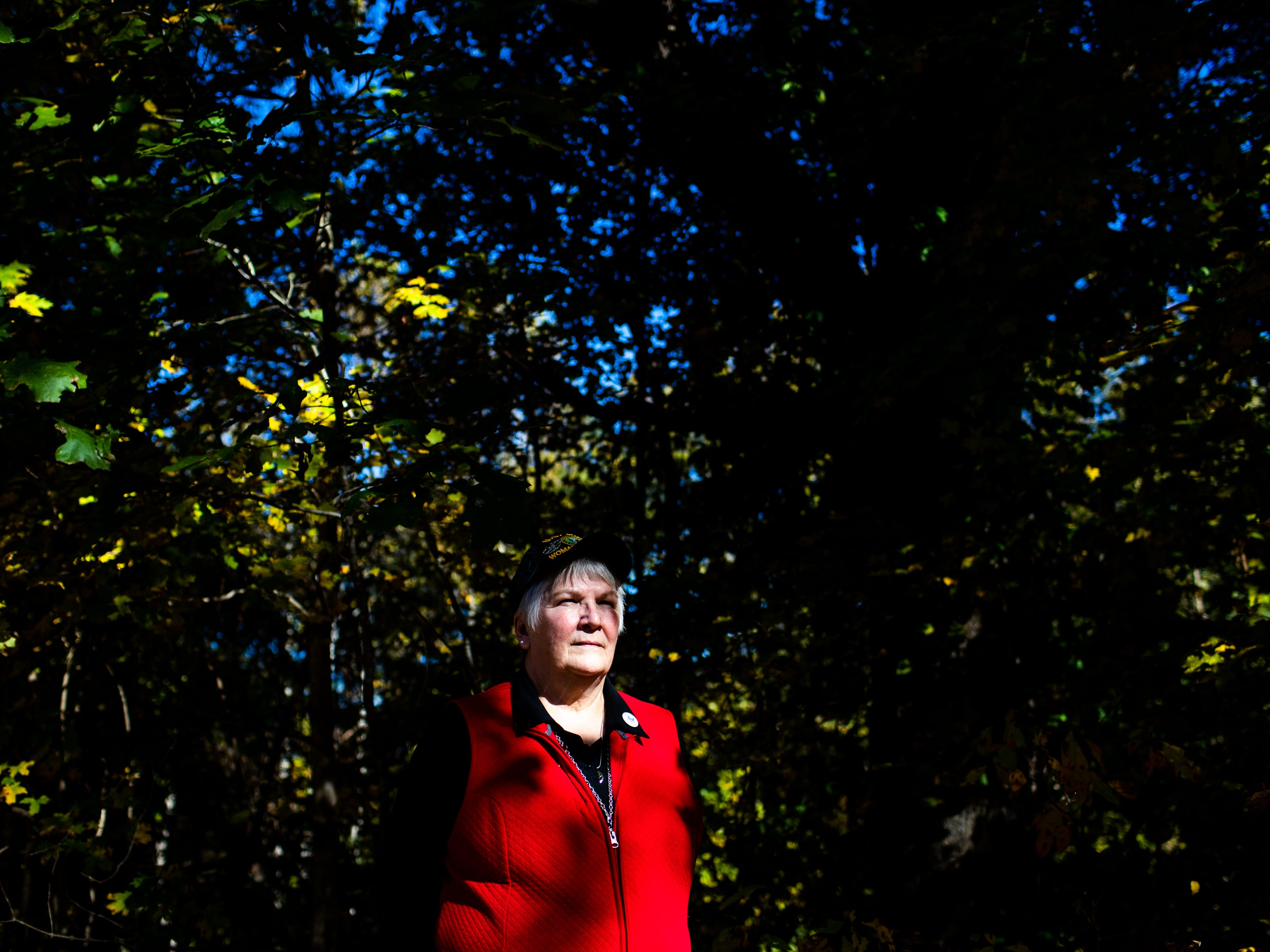 Gulf War veteran Mary Ross stands near the trees at her home Monday, Oct. 29, 2018, in Clarksville, Tenn. Today, Ross isn't always seen as the stereotypical veteran, but she never stops serving.