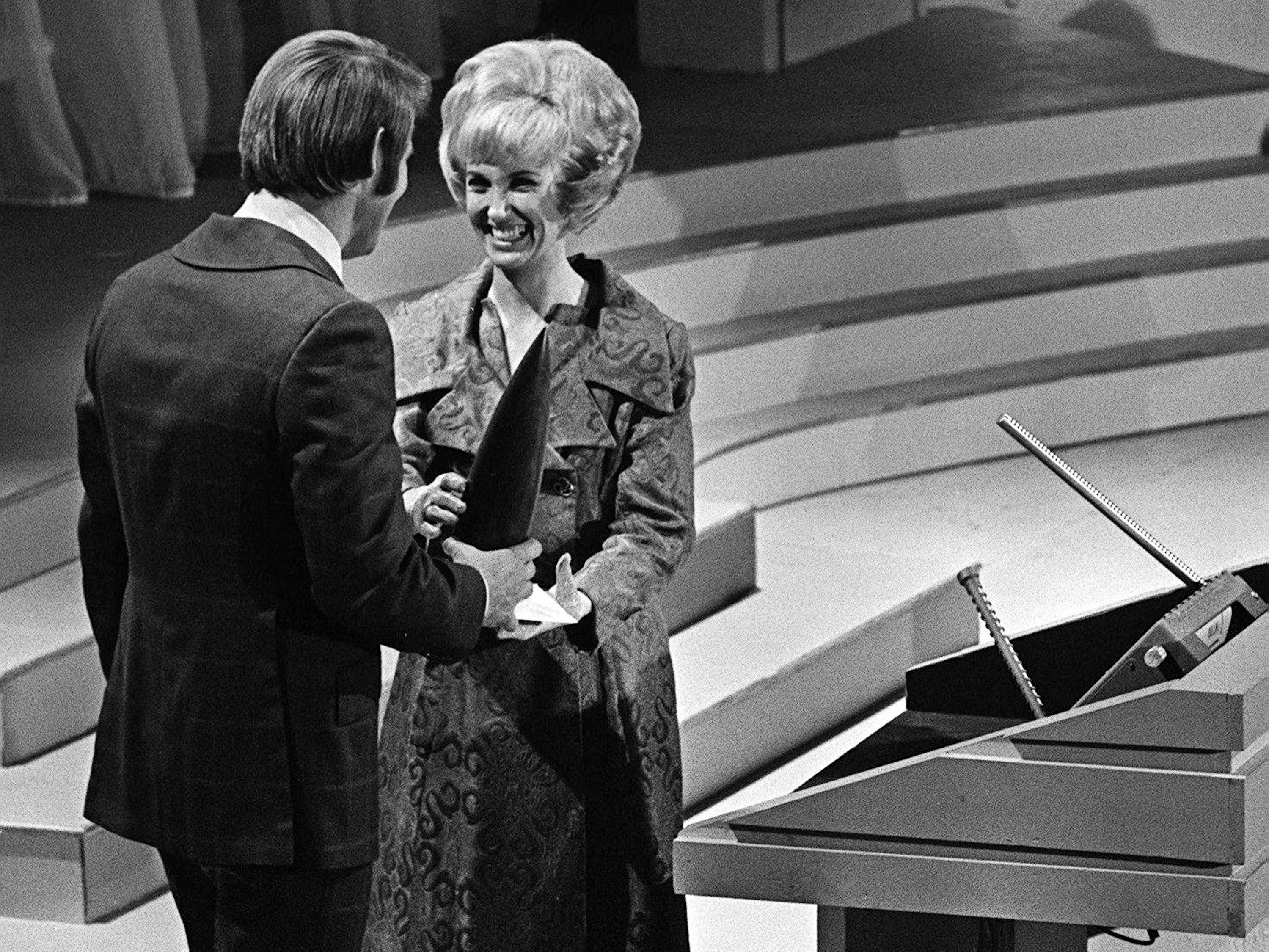 Tammy Wynette accepts the Female Vocalist of the Year award from presenter Glen Campbell during the second annual CMA Awards show at the Ryman Auditorium on Oct. 18, 1968.