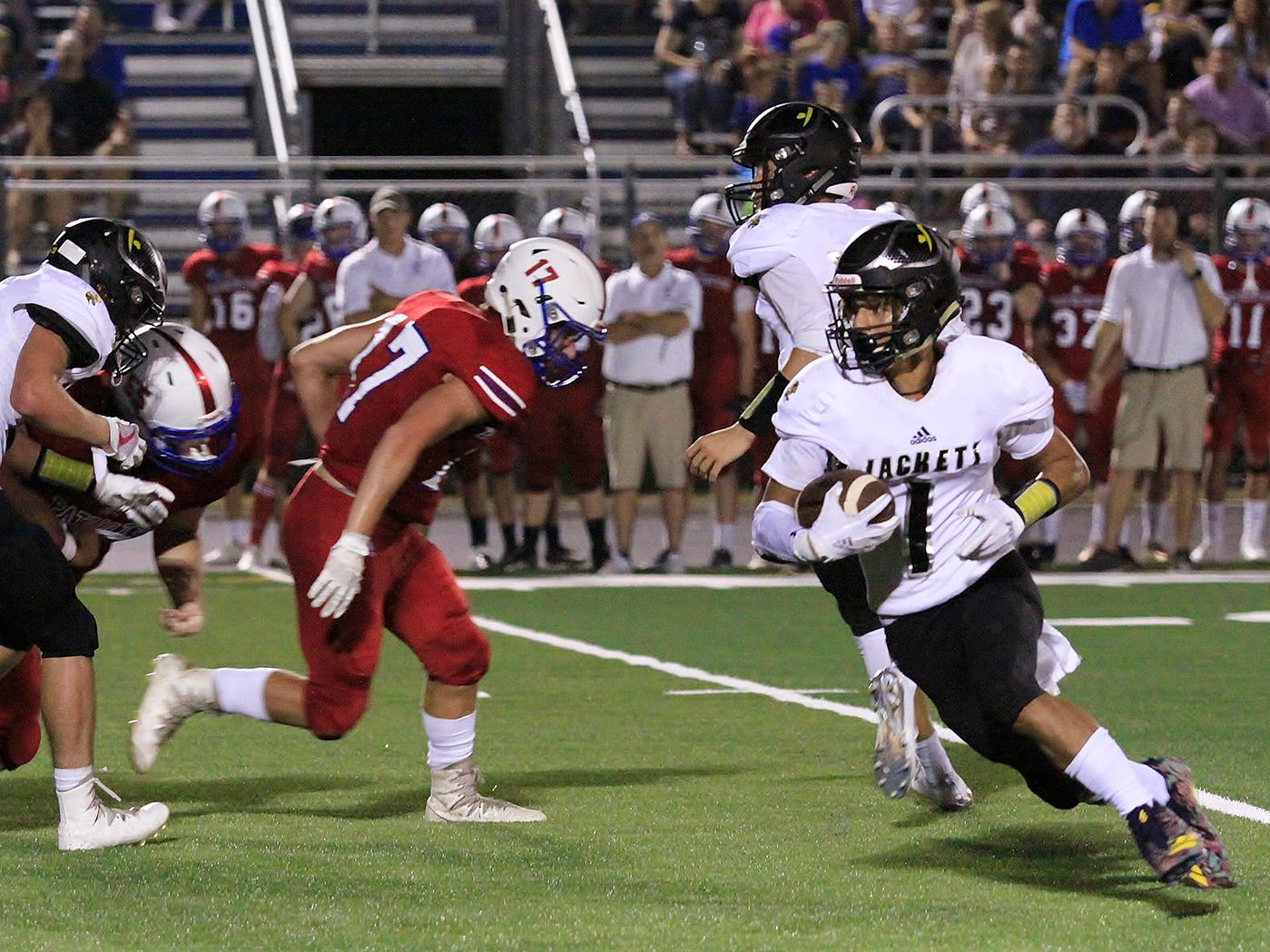 FHS' #1 KamHarris-Lusk races past a Page defender to score a Jacket touchdown August 17, 2018.