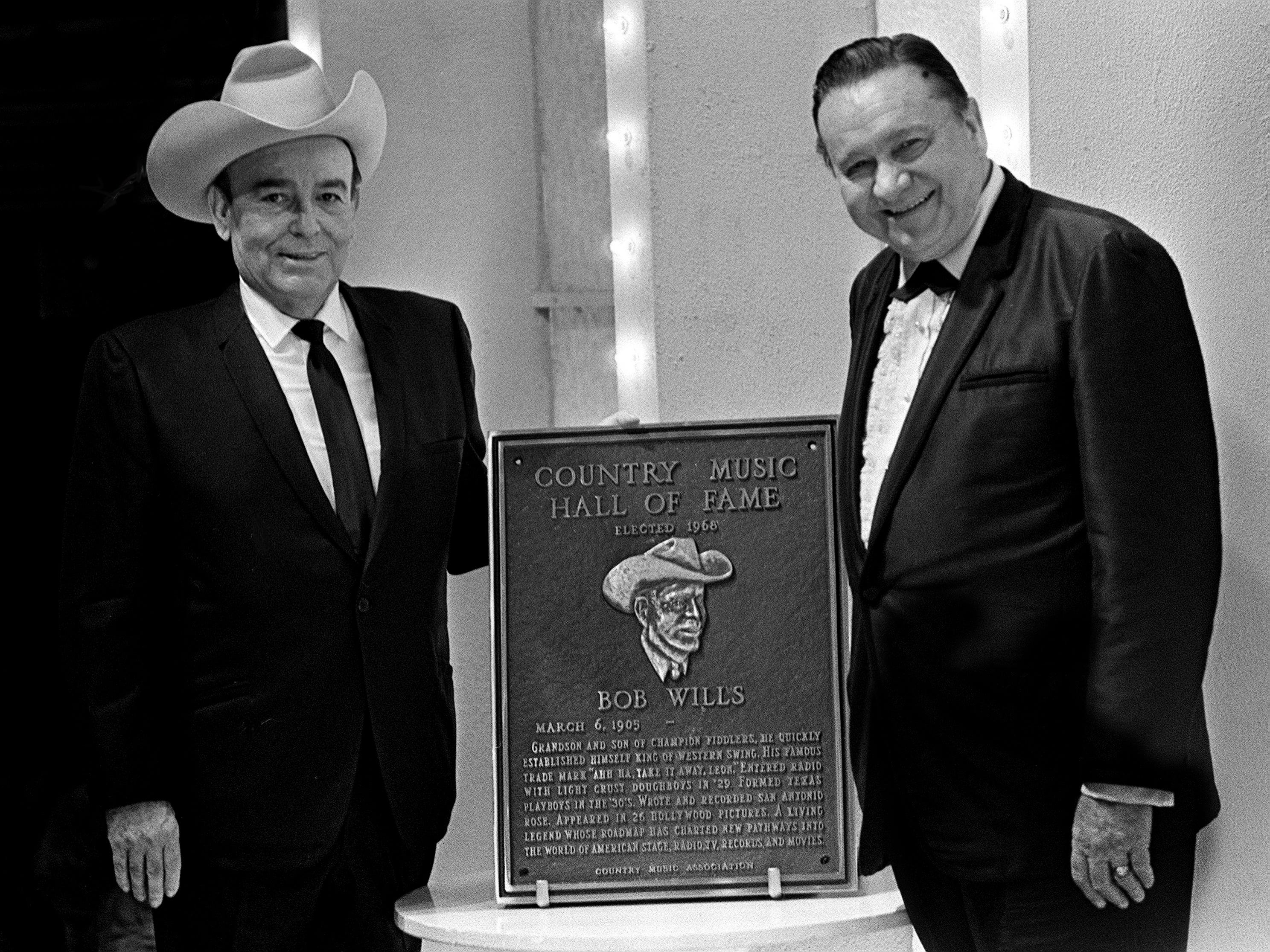 """""""Texas Playboy"""" Bob Wills, left, poses with his plaque after being named to the Country Music Hall of Fame during the second annual CMA Awards show at the Ryman Auditorium on Oct. 18, 1968. Tex Ritter, right, was one of Wills' presenters."""