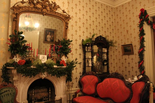 The parlor at Oaklands Mansion in Murfreesboro, Tenn., is decorated for the annual Christmas Candlelight Tour of Homes.