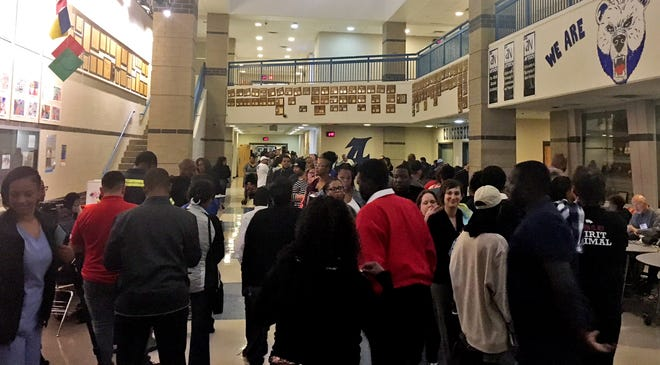 The line at Antioch High School stretches all the way down the hall, estimated to be an 1.5-hour wait at 6:49 p.m. Tuesday, Nov. 6, 2018, according to poll worker Mitzy Johnson, who hasnÕt seen a line this long since the last presidential election.