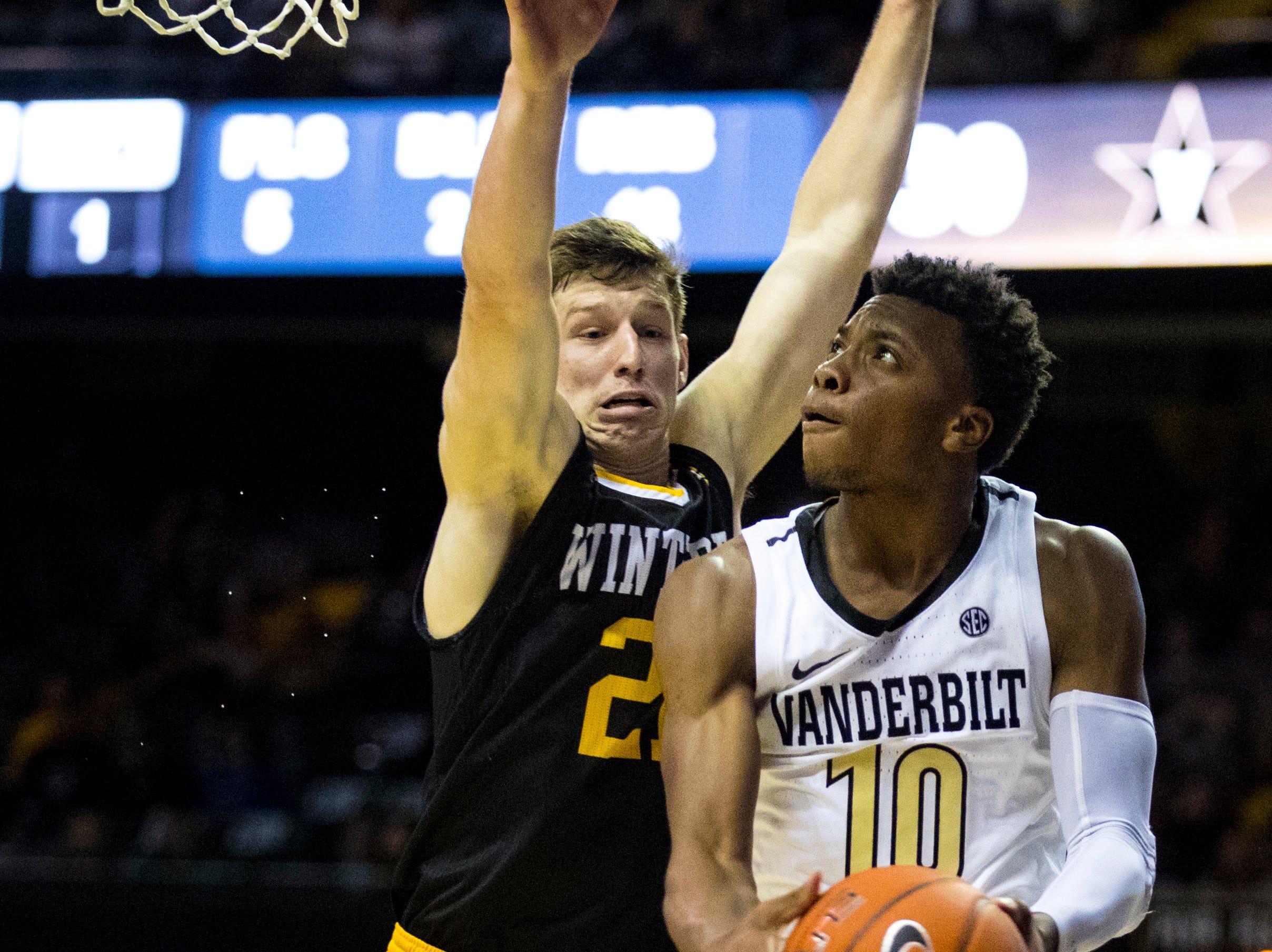 Vanderbilt's Darius Garland (10) gets around Winthrop's Kyle Zunic (21) for a basket during Vanderbilt's game against Winthrop at Memorial Gymnasium in Nashville on Tuesday, Nov. 6, 2018.