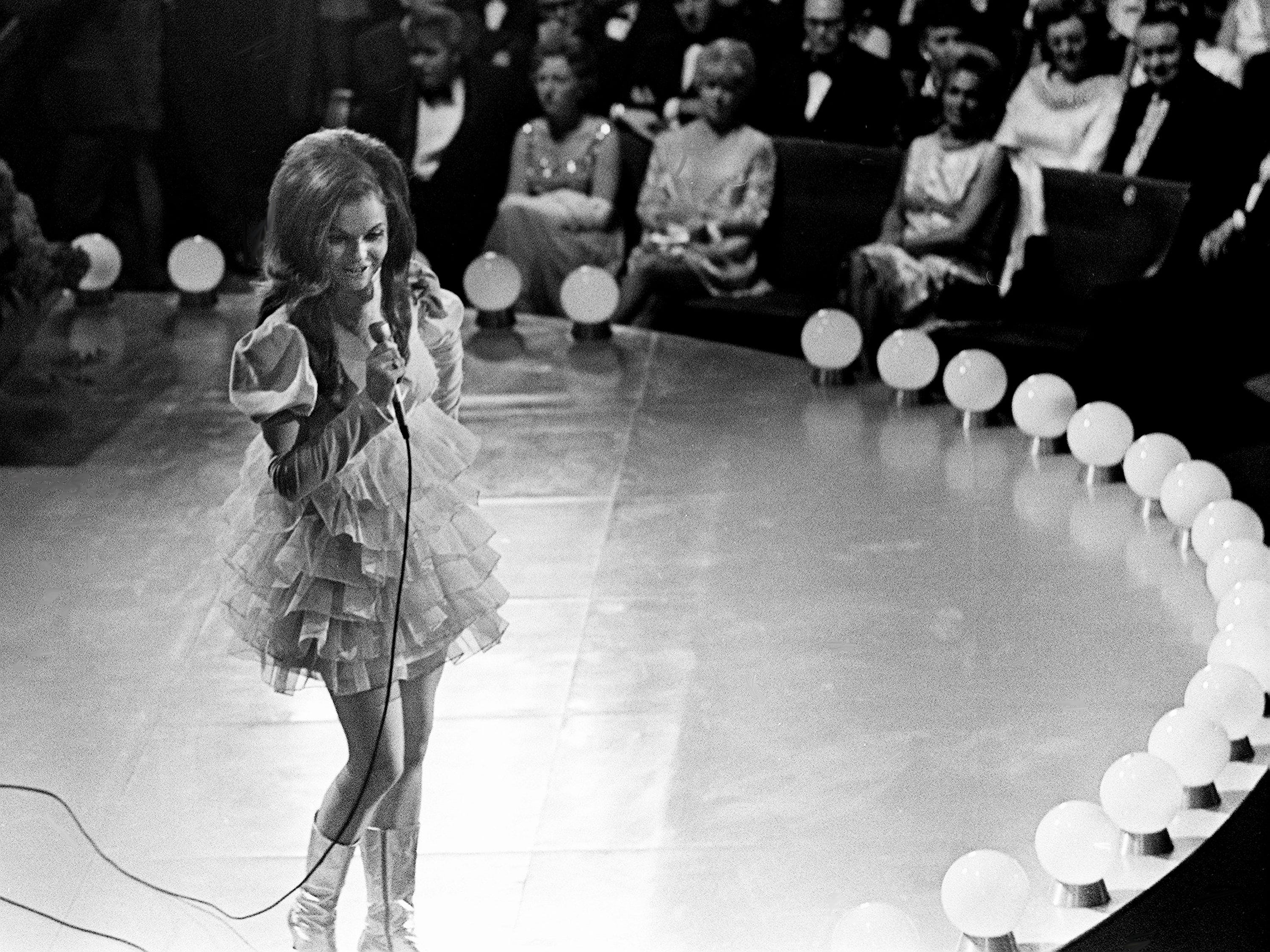 """Jeannie C. Riley performs """"Harper Valley PTA"""" during the second annual CMA Awards show at the Ryman Auditorium on Oct. 18, 1968. She picked up the Single of the Year award for the song."""
