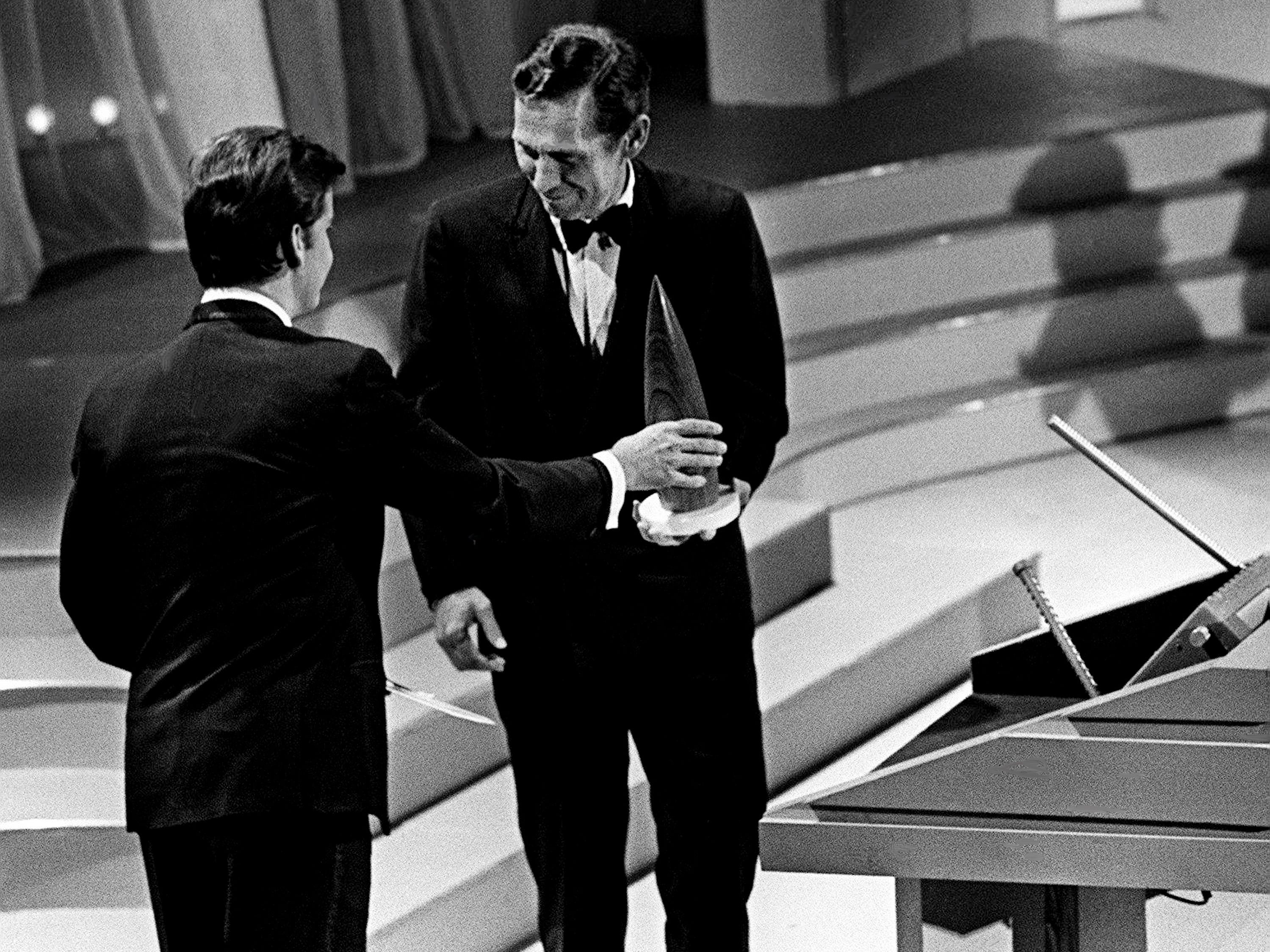 Chet Atkins, right, receives his Instrumentalist of the Year award from presenter Dick Clark during the second annual CMA Awards show at the Ryman Auditorium on Oct. 18, 1968.