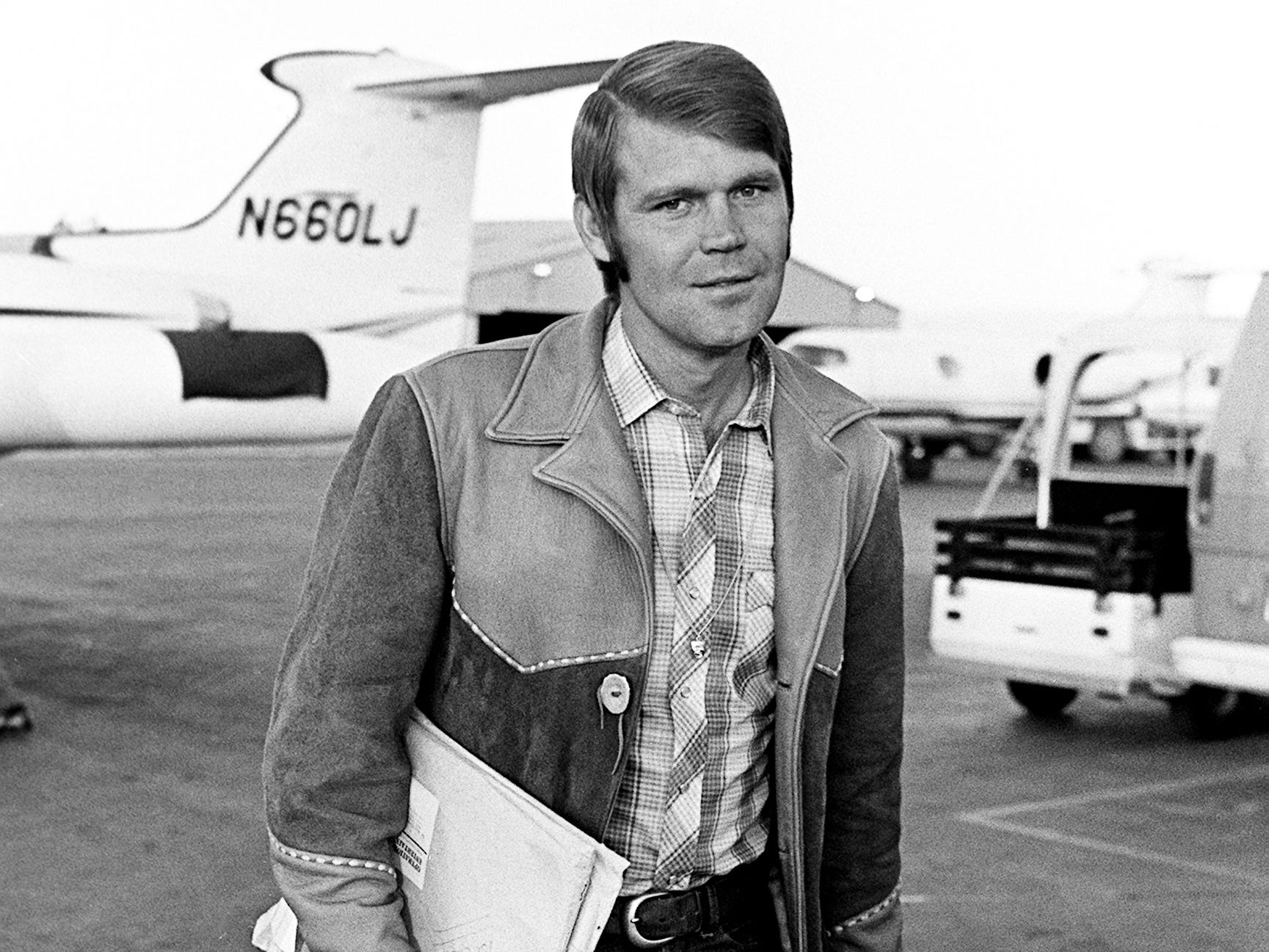 """Glen Campbell arrives in Nashville on a chartered Lear Jet on Oct. 18, 1968, so he was able to just make the second annual CMA Awards show at the Ryman Auditorium. He was on location in Colorado where he is filming """"True Grit"""" with John Wayne."""