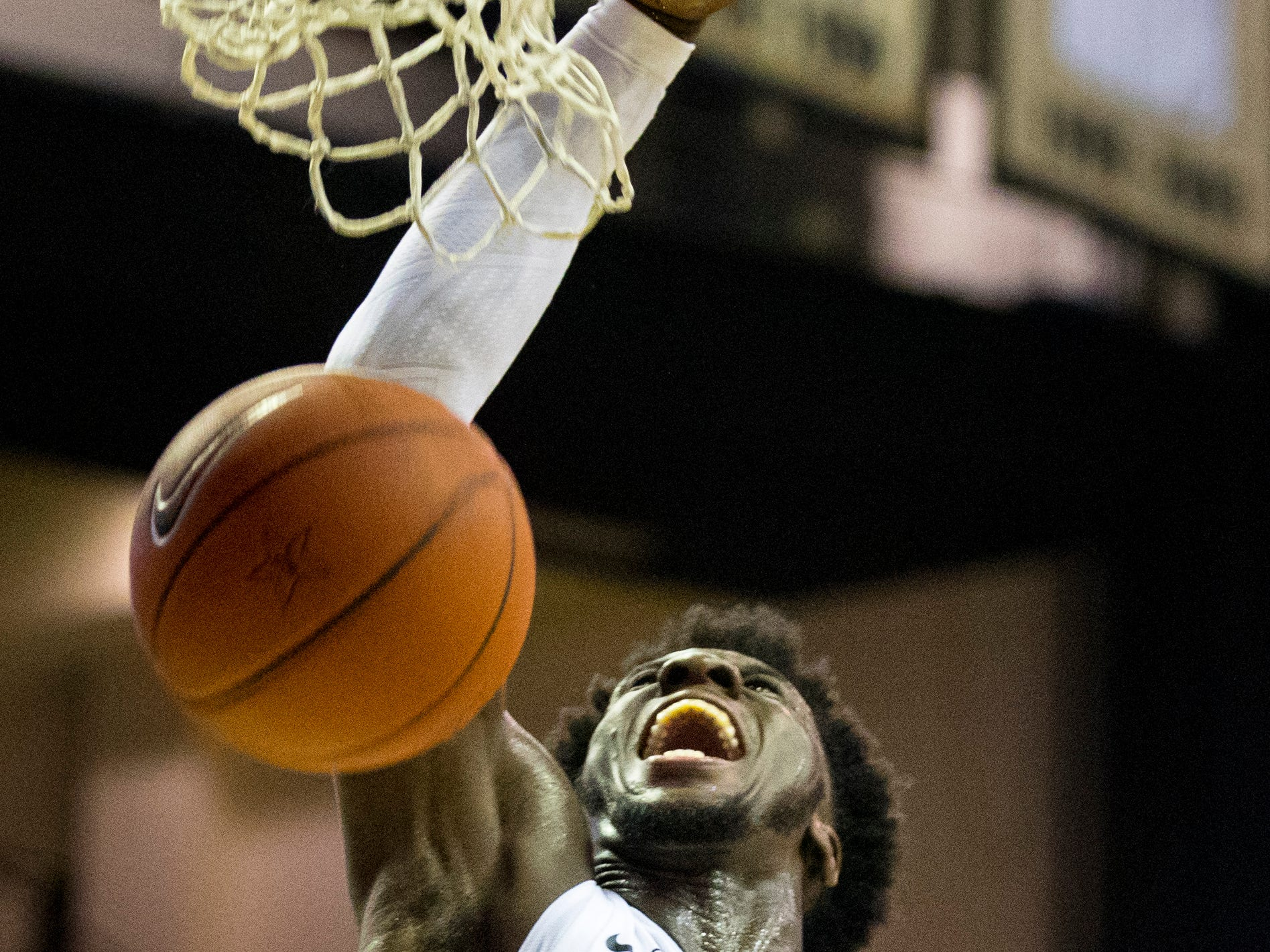Vanderbilt's Simsola Shittu (11) yells as he dunks during Vanderbilt's game against Winthrop at Memorial Gymnasium in Nashville on Tuesday, Nov. 6, 2018.