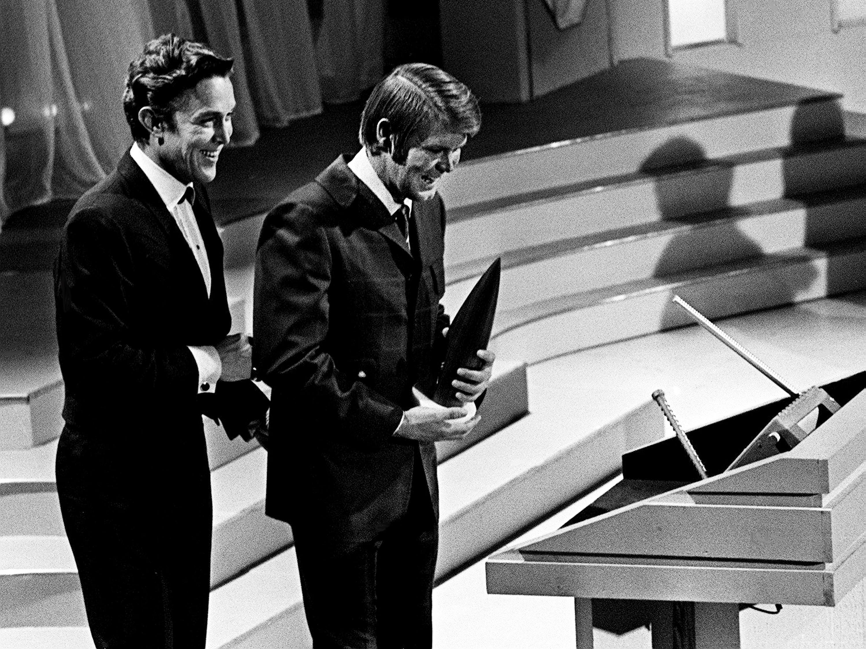 Glen Campbell, right, accepts his Entertainer of the Year award from presenter Jimmy Dean during the second annual CMA Awards show at the Ryman Auditorium on Oct. 18, 1968. Campbell also won the Male Vocalist of the Year award.