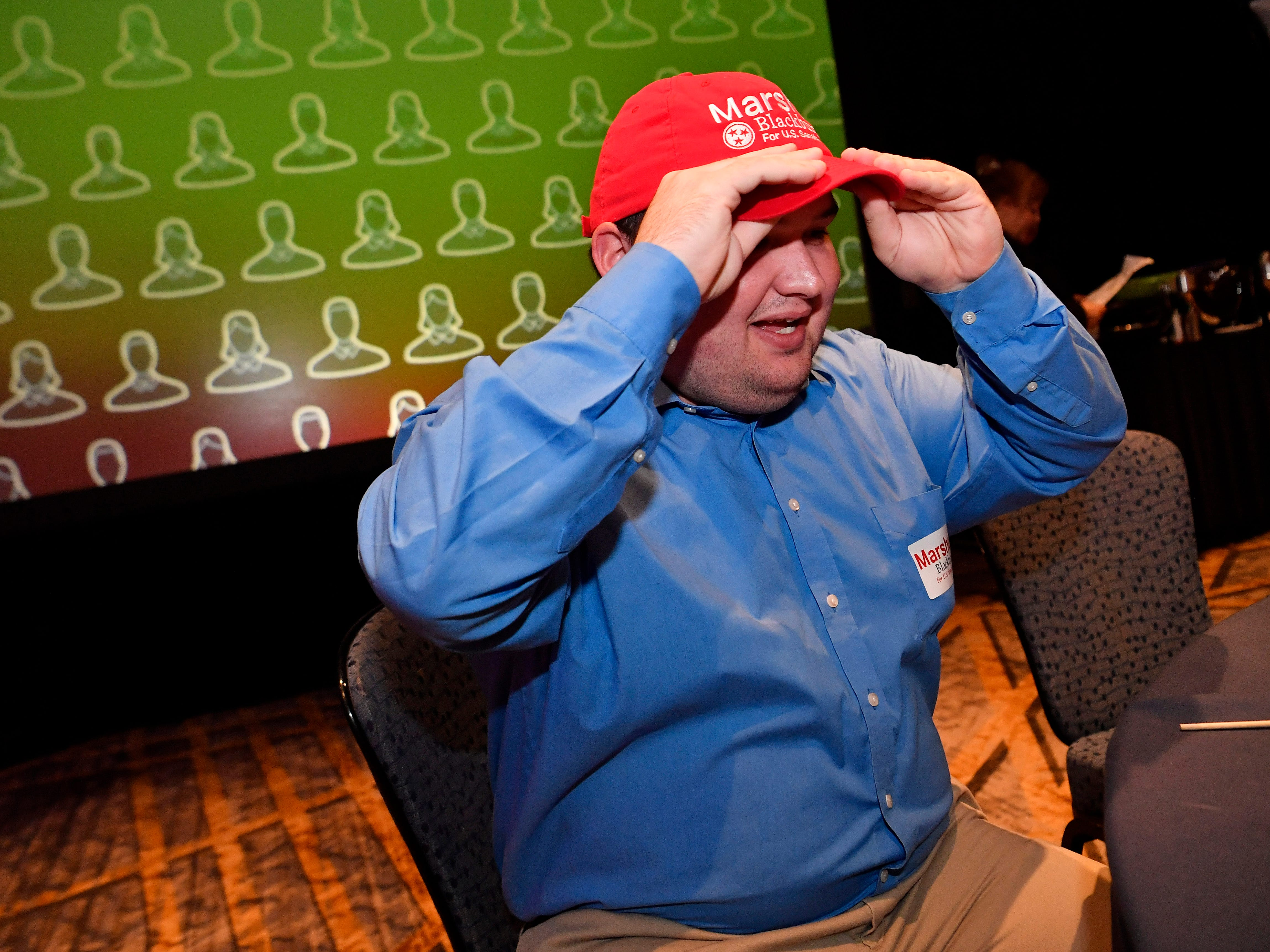Joe Byrne adjusts his Marsha Blackburn hat during the election night watch party for the Republican U.S. Senate candidate Tuesday, Nov. 6, 2018, in Franklin, Tenn.