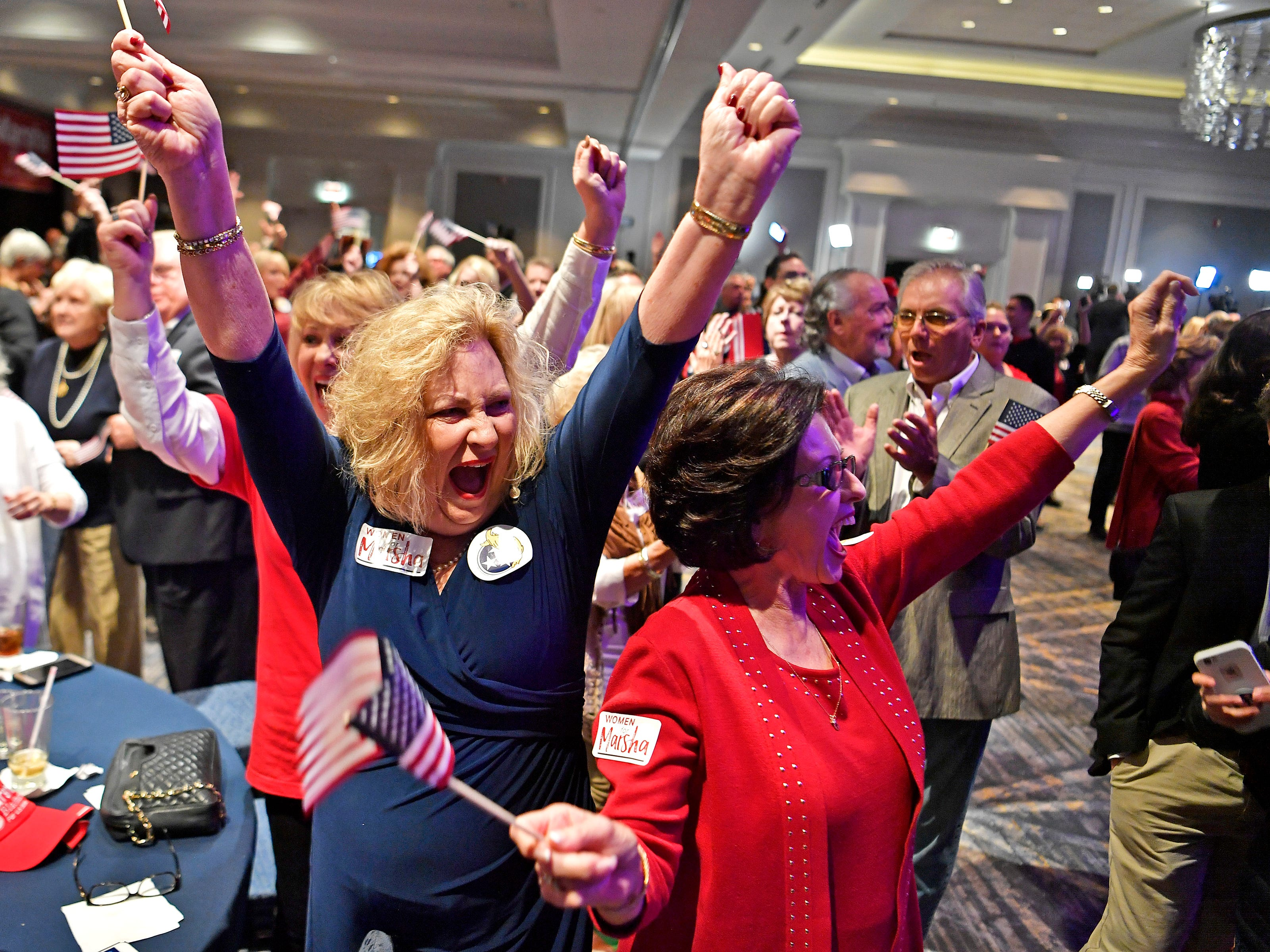 Cheryl Petty and Donna Choate celebrate results at the election night watch party for Republican U.S. Senate candidate Marsha Blackburn Tuesday, Nov. 6, 2018, in Franklin, Tenn.