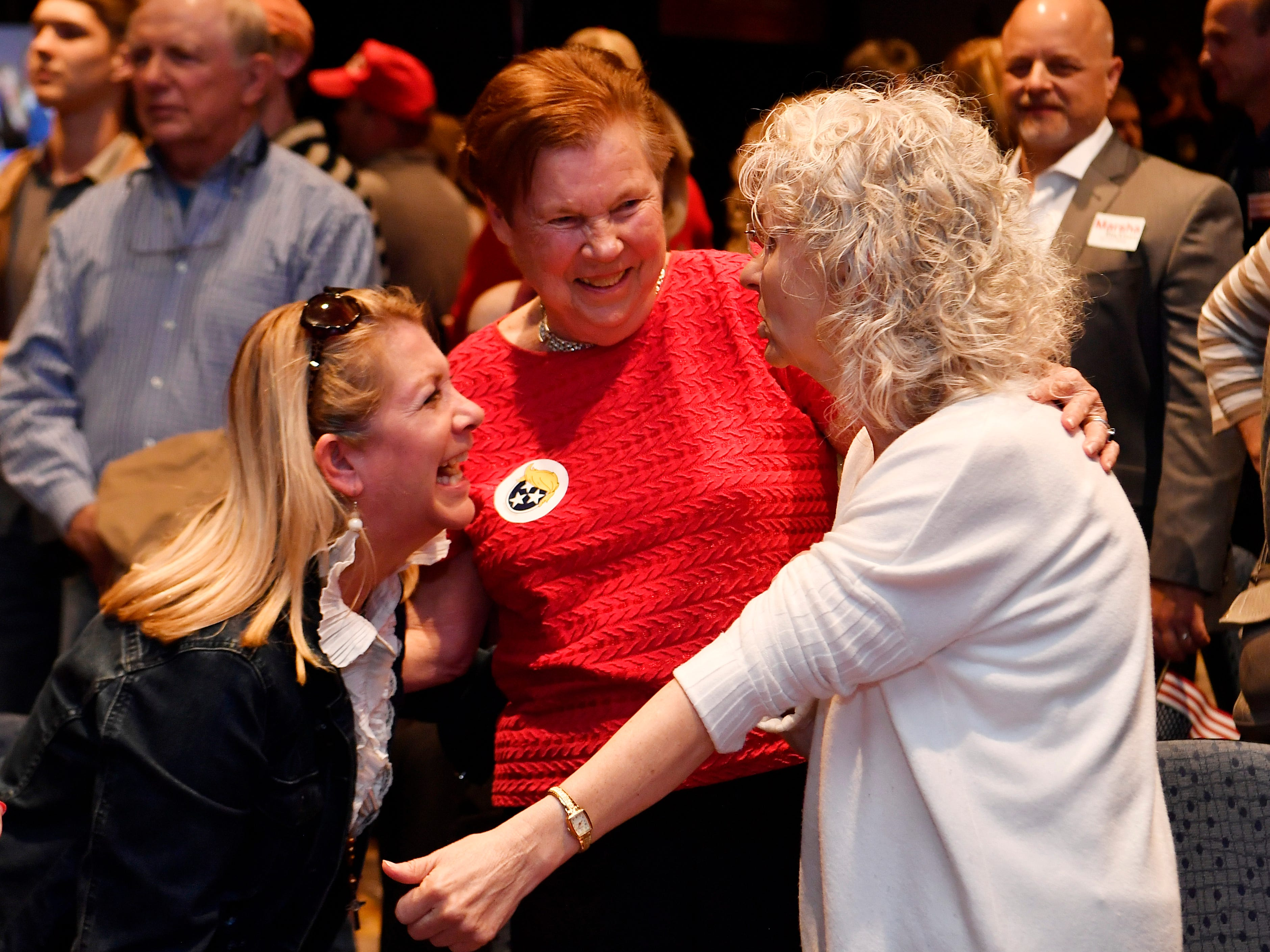 From left, Jamie Hill, Virginia Mitchell and Betsy Carroll celebrate during the election night watch party for Republican U.S. Senate candidate Marsha Blackburn  Tuesday, Nov. 6, 2018, in Franklin, Tenn.