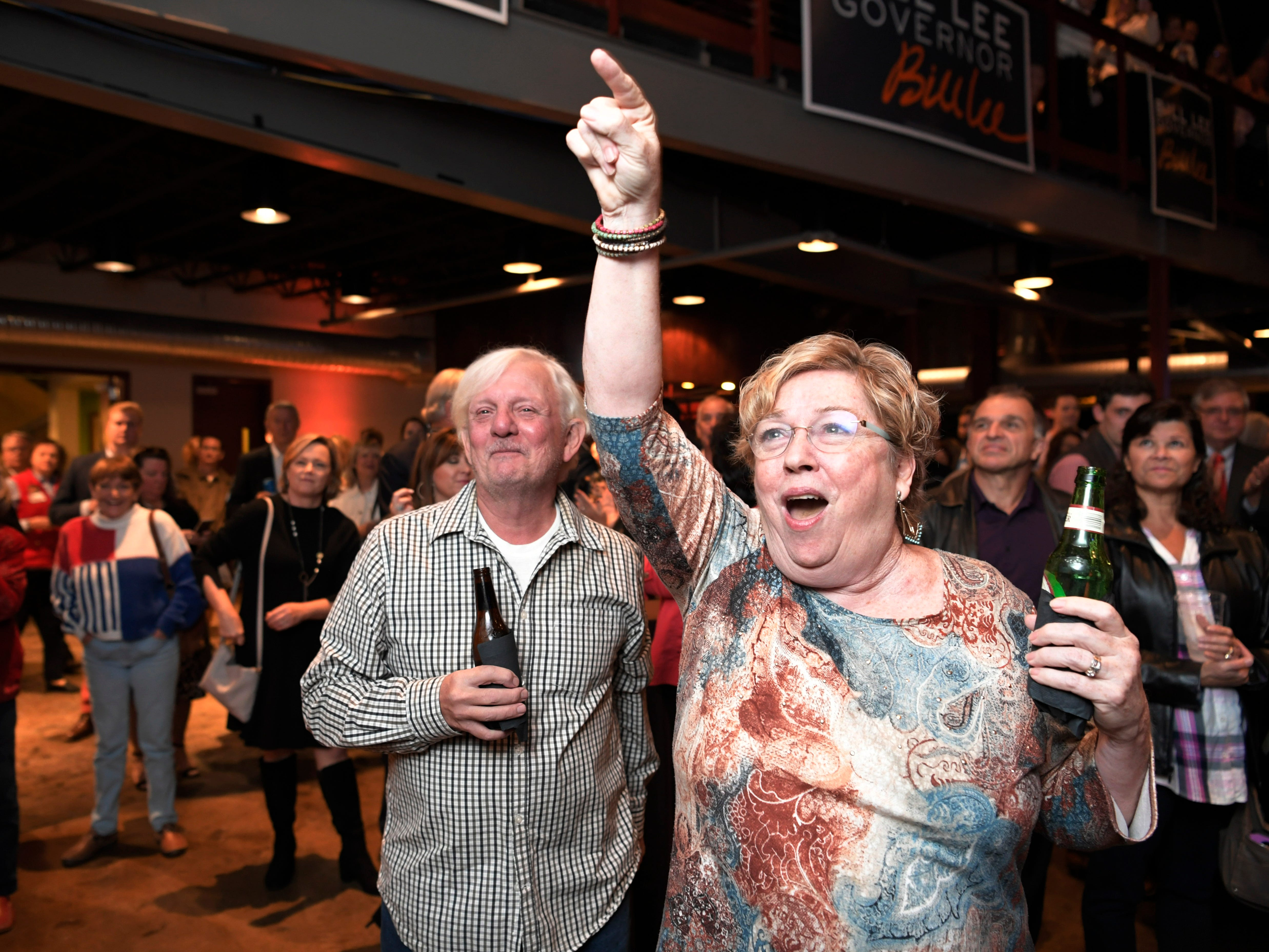 Mary Neil and her husband Findlay of Nashville cheer as election results come in during the election party for Republican gubernatorial candidate Bill Lee at the Factory in Franklin, Tenn. on Tuesday, Nov. 6, 2018.
