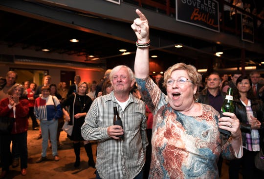 Mary Neil and her husband Findlay of Nashville cheer as election results come in during the election party for Republican gubernatorial candidate Bill Lee at the Factory in Franklin on Tuesday.