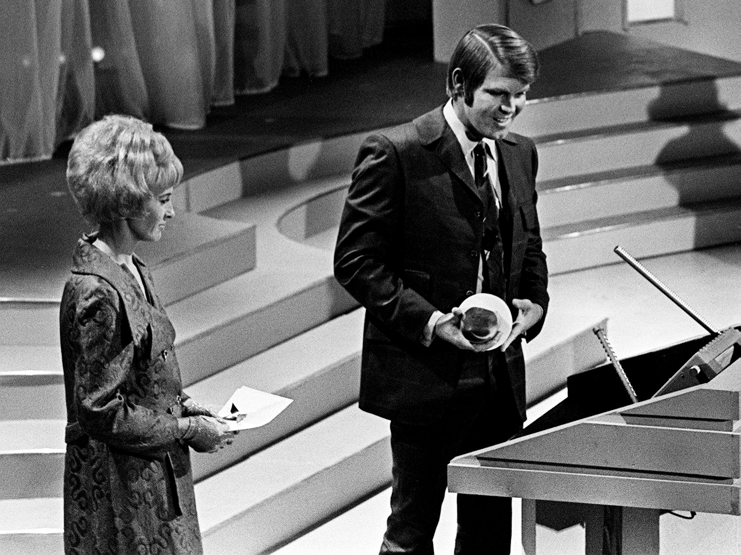 Glen Campbell speaks to the crowd after accepting the Male Vocalist of the Year award from presenter Tammy Wynette during the second annual CMA Awards show at the Ryman Auditorium on Oct. 18, 1968. Campbell also picked up the Entertainer of the Year award.