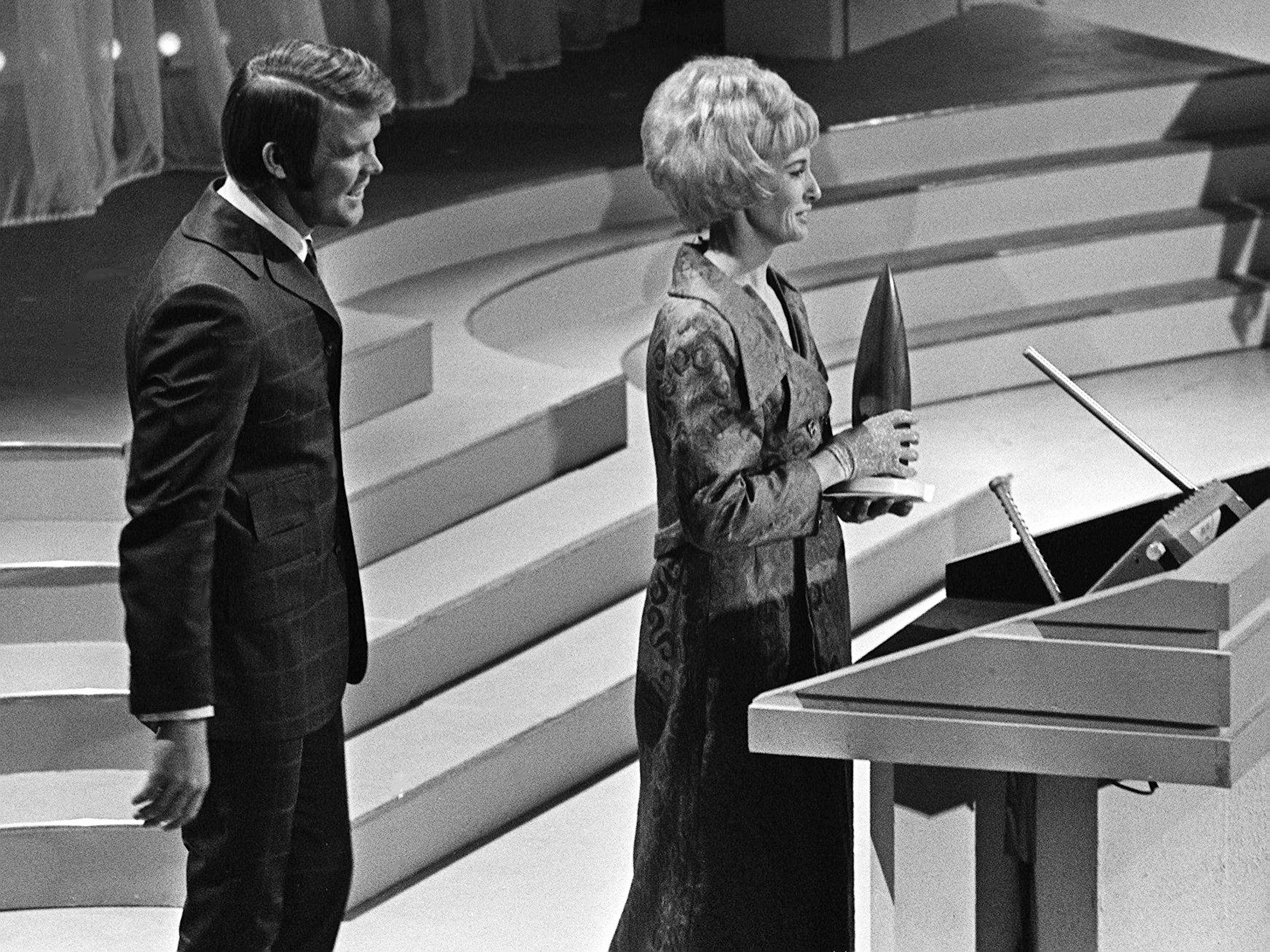 Tammy Wynette speaks to the crowd after accepting the Female Vocalist of the Year award from presenter Glen Campbell during the second annual CMA Awards show at the Ryman Auditorium on Oct. 18, 1968.