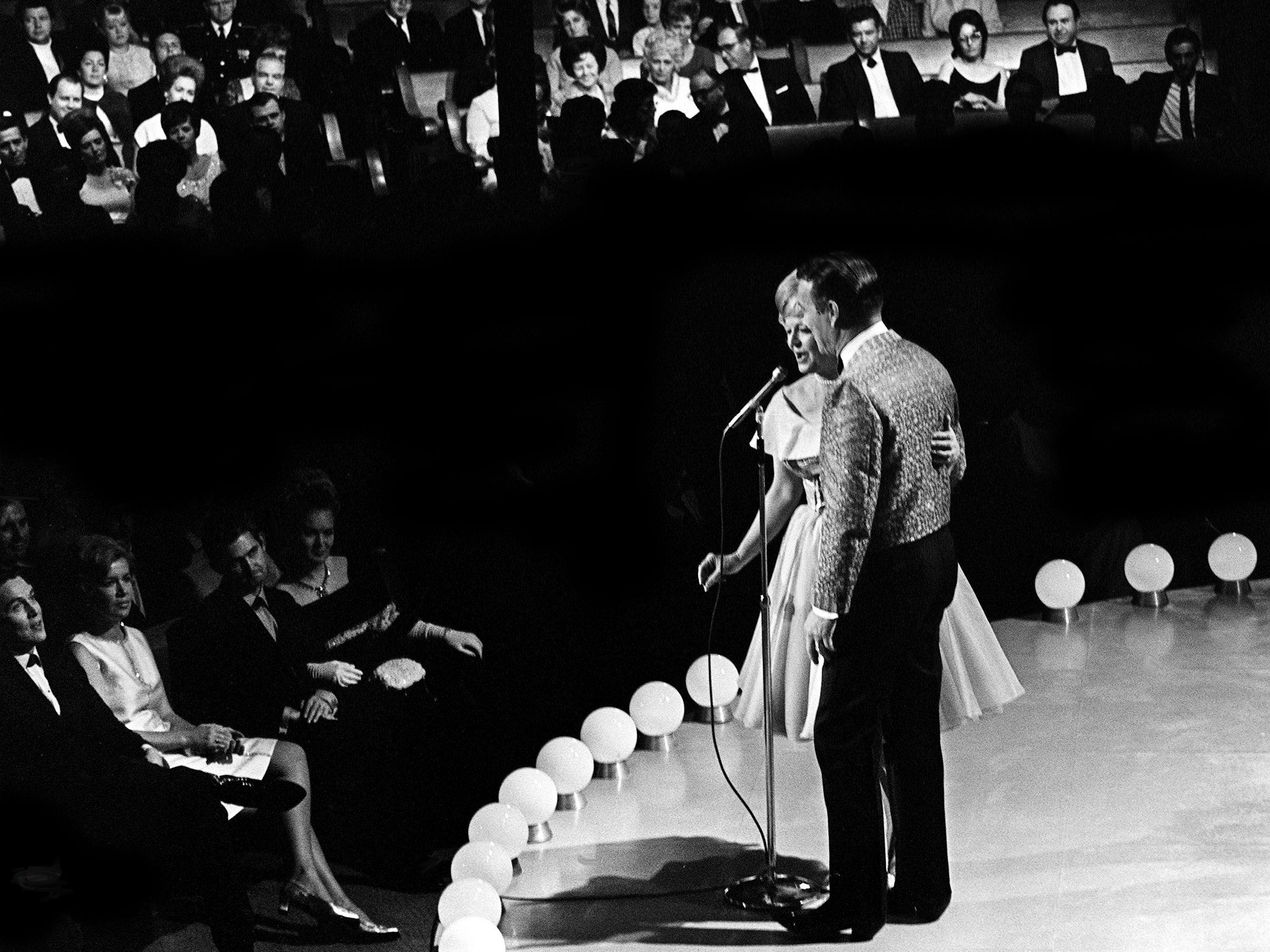 """Emcees Roy Rogers and Dale Evans greet the crowd during the second annual CMA Awards show at the Ryman Auditorium on Oct. 18, 1968. The show was taped by NBC for airing on the """"Kraft Music Hall."""""""