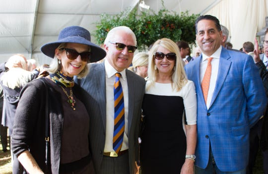Jackie and John Hicks, Renee and Mark Poe attend the 29th annual Sunday in the Park.