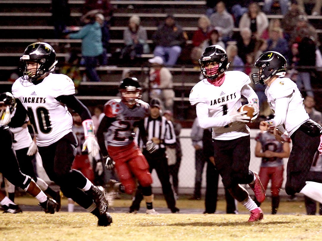 With solid blocking by #40 Brody Cox, #1 Kam Harris-Lusk runs for a Yellow Jacket first down in Fairview's 39-7 win over Cheathamer 26, 2018.
