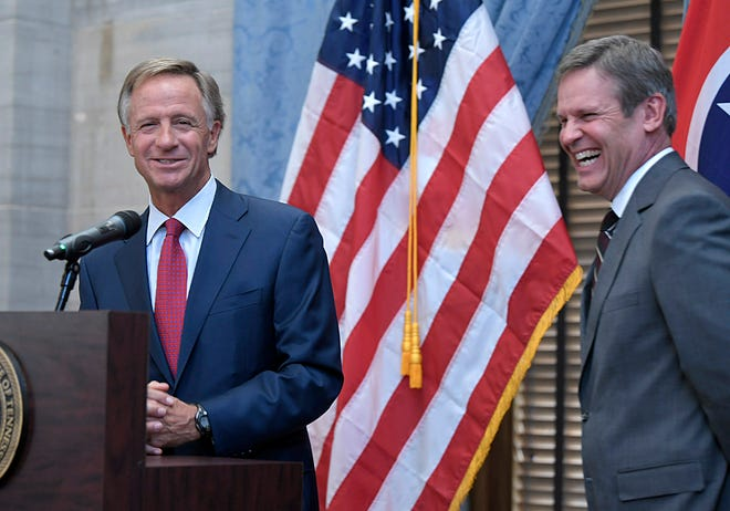 Tennessee Gov. Bill Haslam and Gov.-elect Bill Lee joke about Lee's campaign RV during a joint news conference Wednesday at the state Capitol. Lee met with Haslam to begin going over details of the transition as Lee prepares to take office in January.