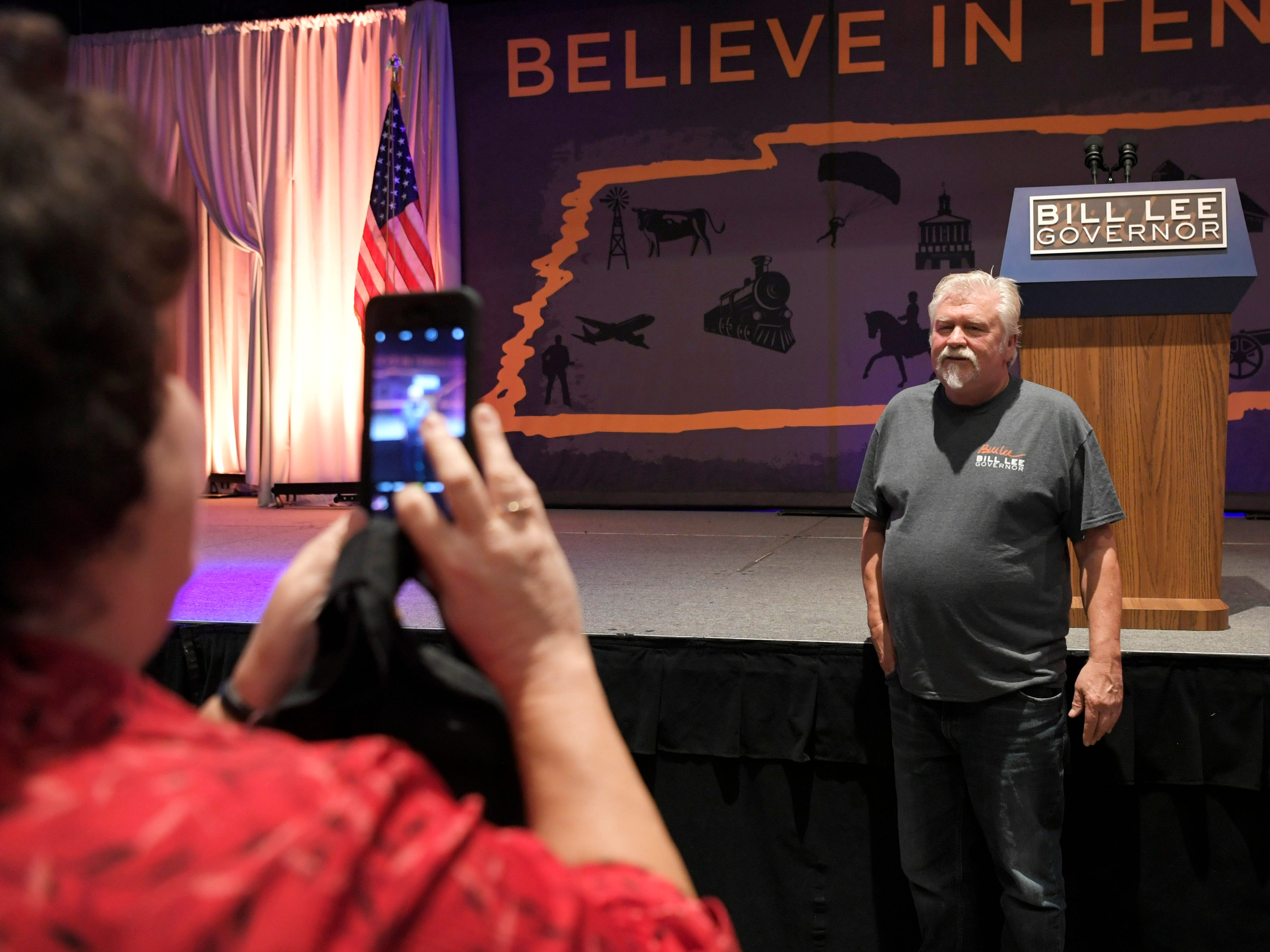 Joyce Jennette takes a photo of her husband, Tony, of Pegrom, at the election party for Republican gubernatorial candidate Bill Lee at the Factory in Franklin, Tenn. on Tuesday, Nov. 6, 2018. Joynce Jennette said she went to middle school with Bill Lee.