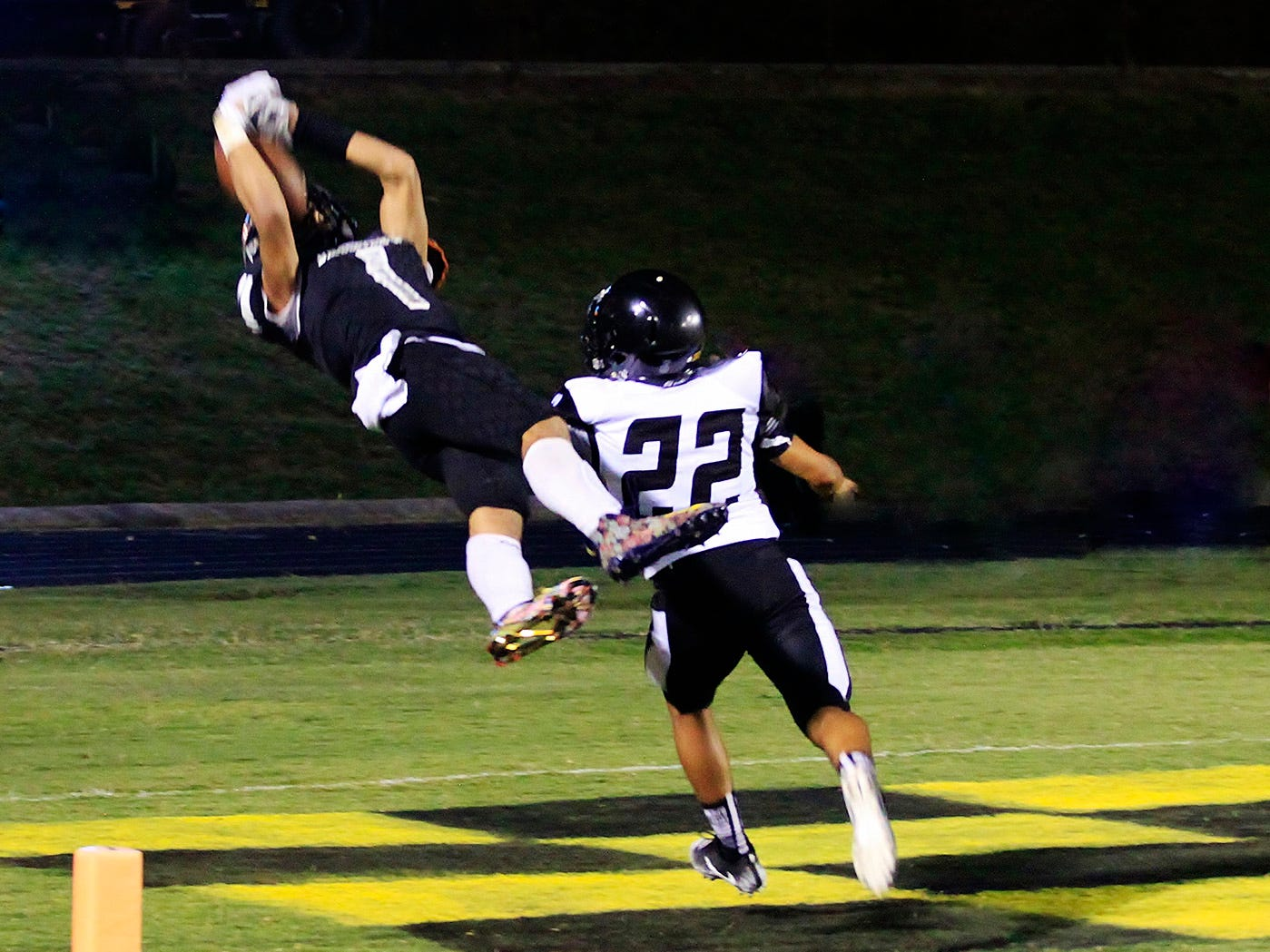 Fairvew's Kam Harris-Lusk dives into the endzone for a catch and a touchdown in 21-14 win over Camden.