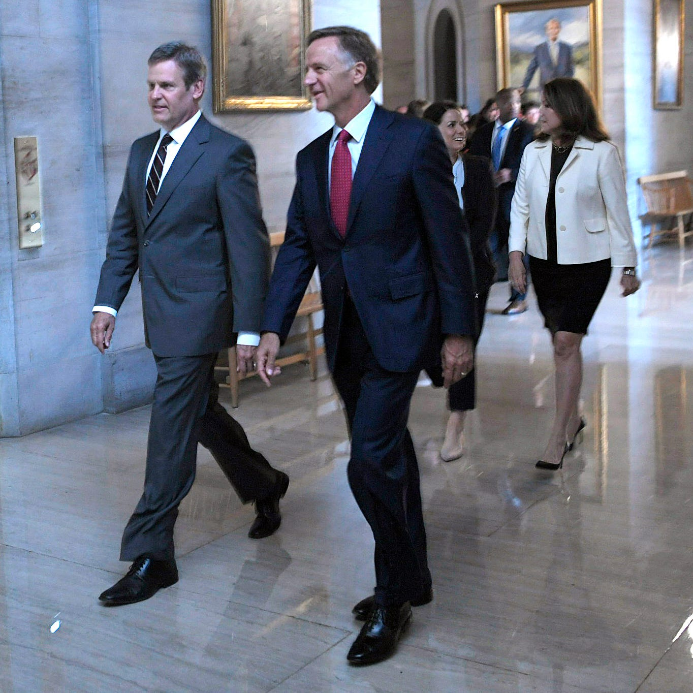 Governor-elect Bill Lee and his wife, Maria, and Governor Bill Haslam and his wife, Crissy, walk together to a joint press conference on Wednesday, Nov. 7, 2018 at the Tennessee State Capitol.