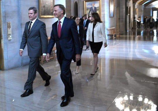 Gov.-elect Bill Lee and his wife, Maria, and Gov. Bill Haslam and his wife, Crissy, walk together to a joint press conference Nov. 7 at the Tennessee State Capitol.