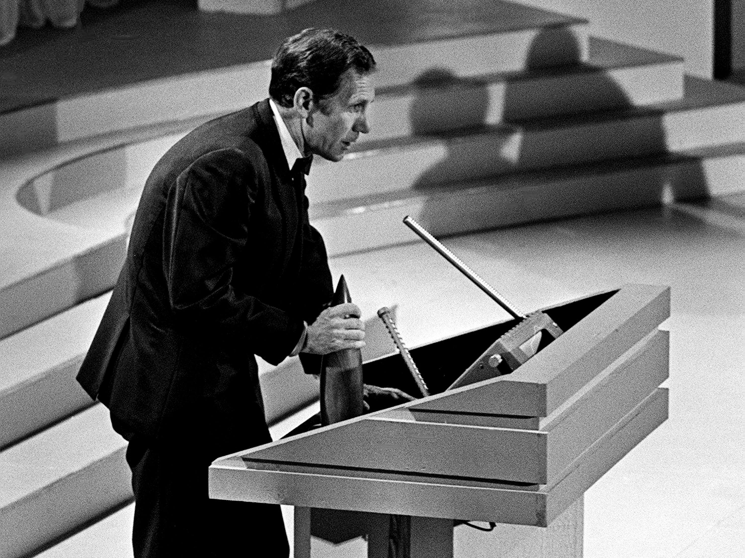 Chet Atkins speaks to the crowd after accepting his Instrumentalist of the Year award during the second annual CMA Awards show at the Ryman Auditorium on Oct. 18, 1968.