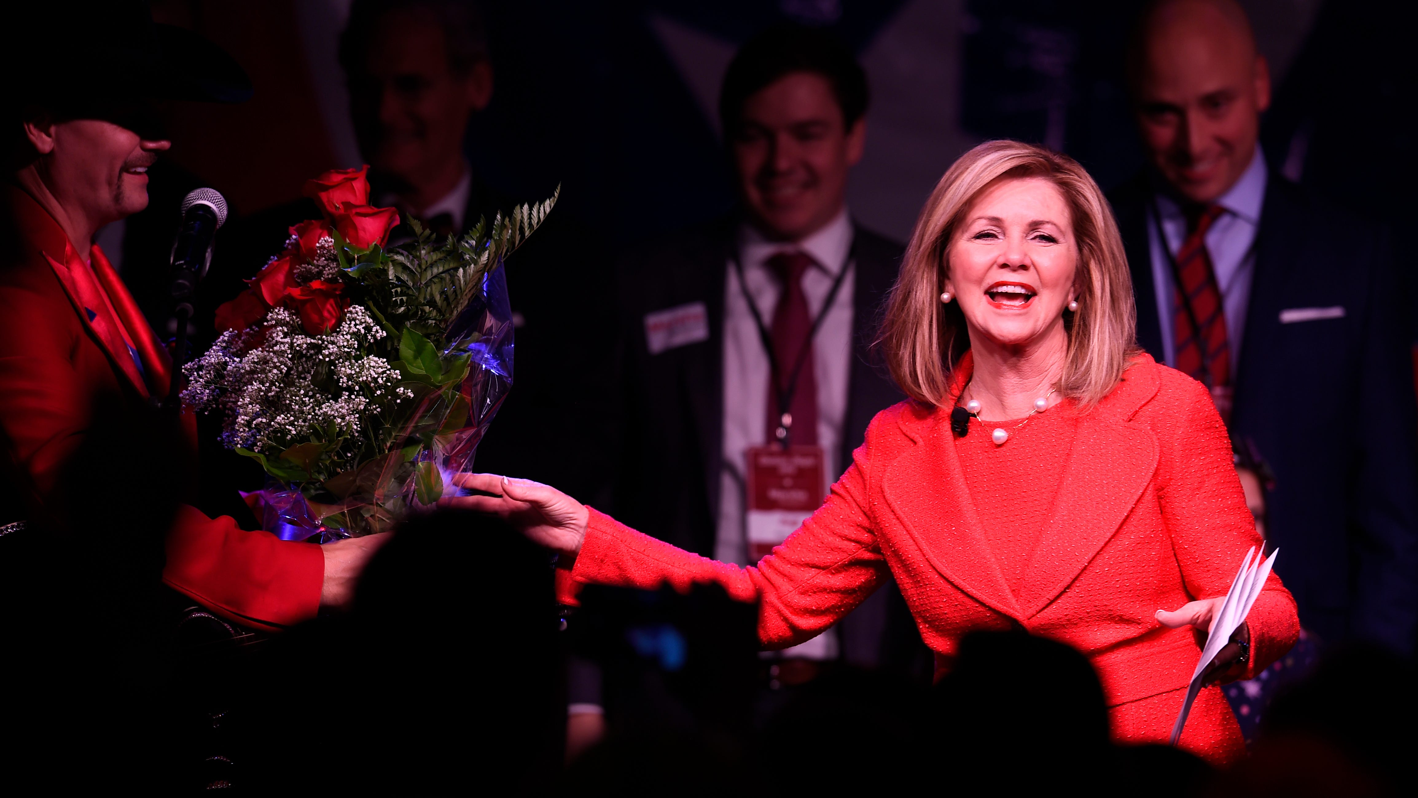 Country artist John Rich presents Senator-elect Marsha Blackburn with flowers at her election night watch party Tuesday, Nov. 6, 2018, in Franklin, Tenn.