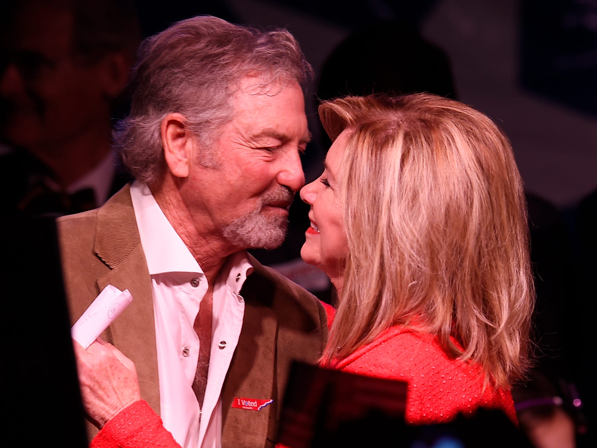 Senator-elect Marsha Blackburn embraces country artist Larry Gatlin after declaring victory at her election night watch party Tuesday, Nov. 6, 2018, in Franklin, Tenn.